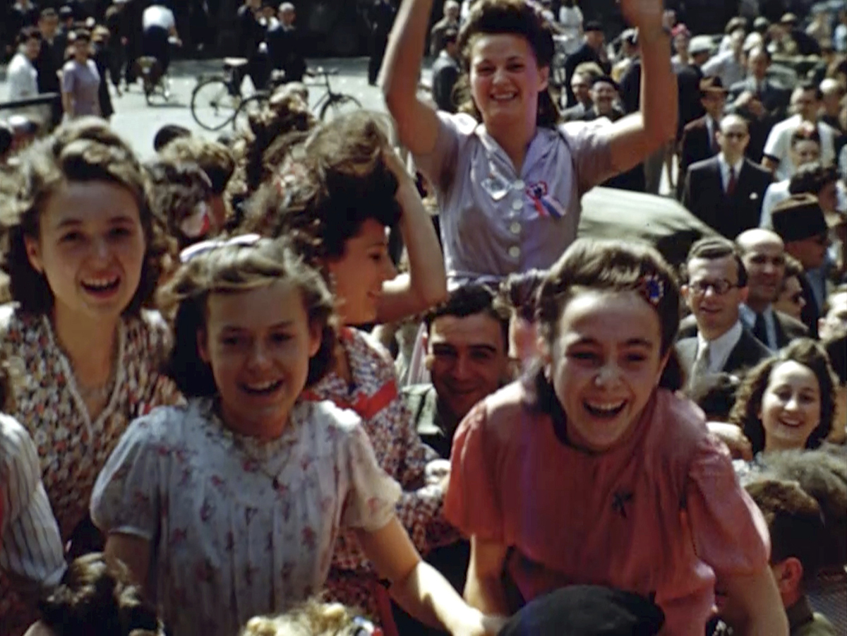French women cheer U.S. soldiers after the liberation of Paris in 1944 during World War II. Seventy-five years later, surprising color images of the D-Day invasion and aftermath bring an immediacy to wartime memories. They were filmed by Hollywood director George Stevens and rediscovered years after his death. (War Footage From the George Stevens Collection at the Library of Congress via AP)