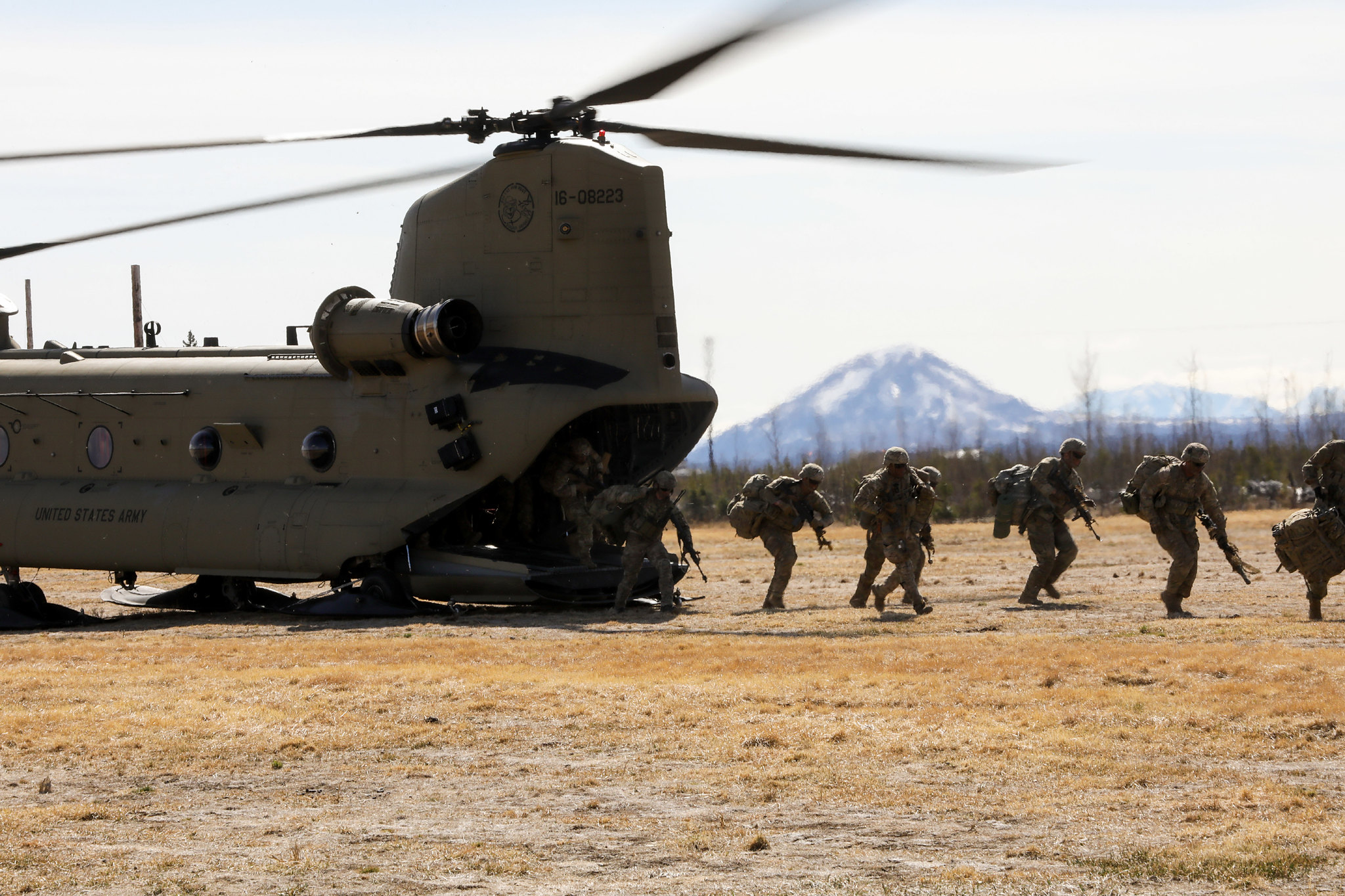 Paratroopers exit a CH-47 Chinook on May 10, 2021, as they conduct an air assault during exercise Northern Edge 21 at Fort Greely, Alaska. (Staff Sgt. Alex Skripnichuk/Army)