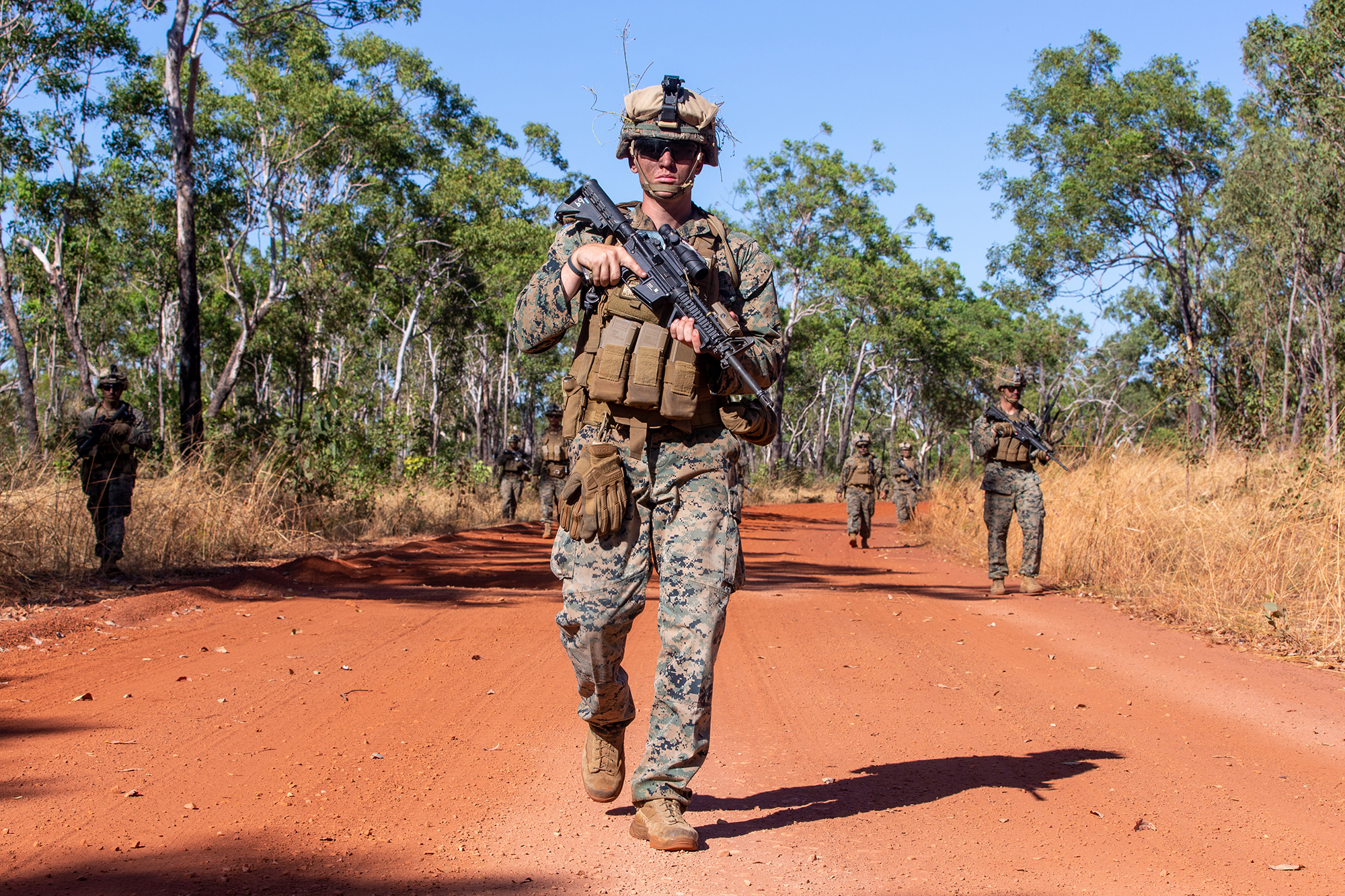 Marine Corps Cpl. Dalton Boswell walks in formation May 28, 2021, during ground threat reaction drills at Mount Bundy Training Area, NT, Australia. (Master Sgt. Sarah Nadeau/Marine Corps)