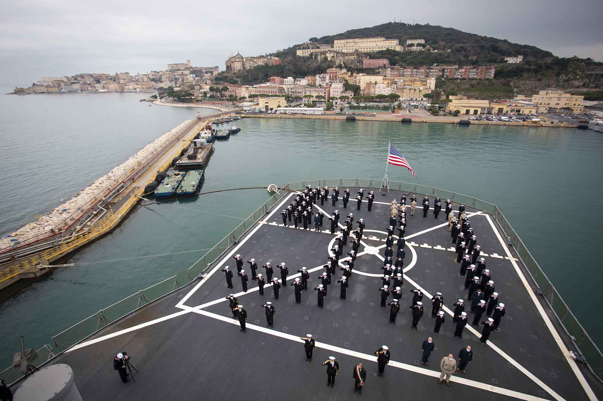 The crew of the USS Mount Whitney stands in formation during the ship's 50th anniversary celebration in Gaeta, Italy, Jan. 14, 2021. (Petty Officer 2nd Class Jared Kercell/Navy)