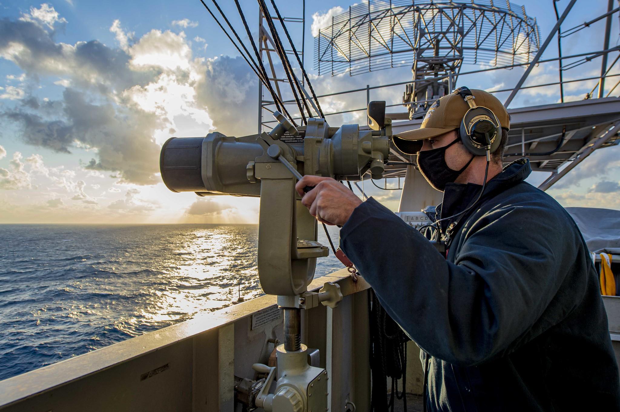 Seaman Cedric Volle stands aft lookout watch aboard the Nimitz-class aircraft carrier USS Dwight D. Eisenhower (CVN 69) in the Mediterranean Sea, April 1, 2021. (Mass Communication Specialist Seaman Jacob Hilgendorf/Navy)