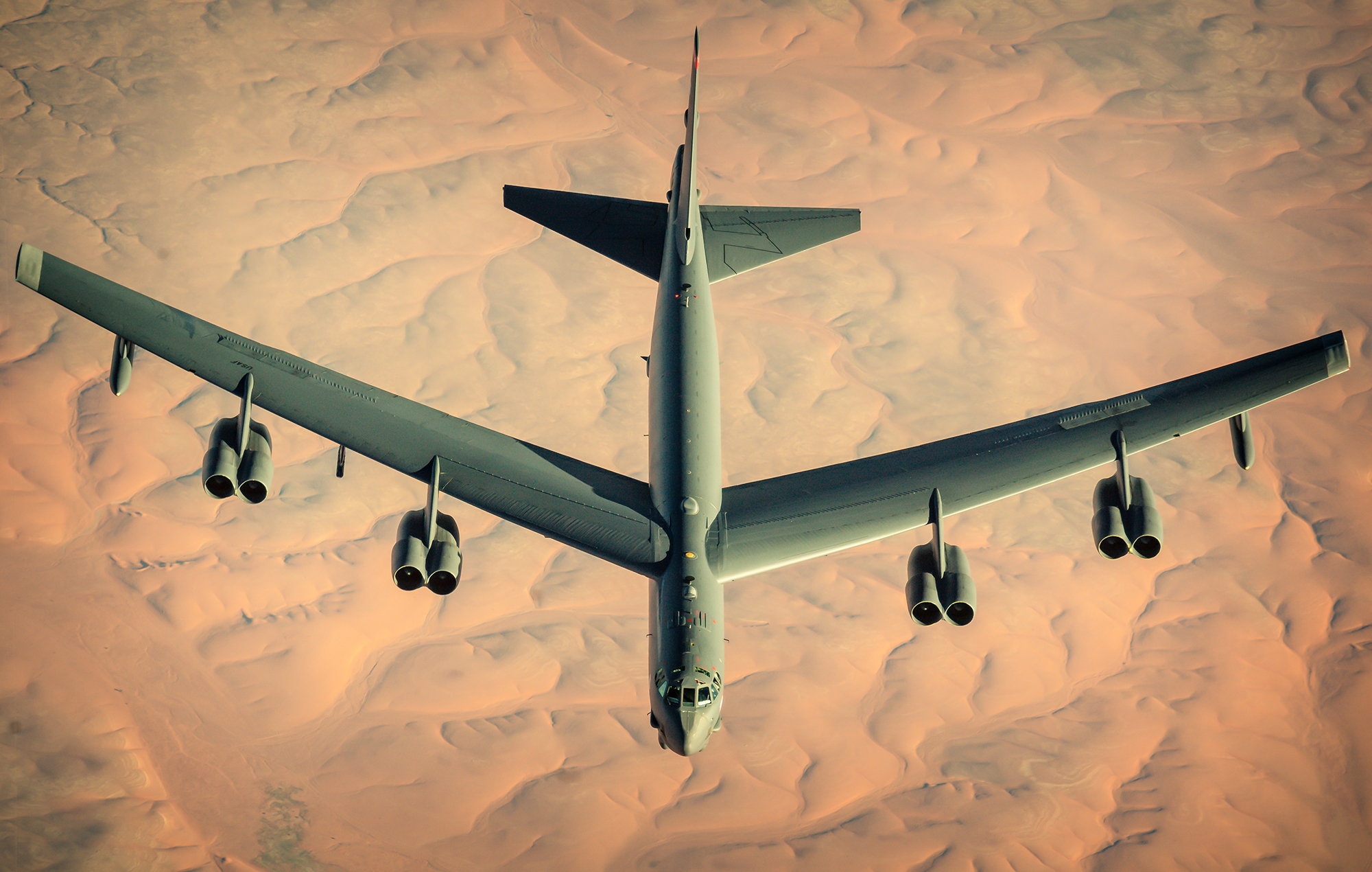 A U.S. Air Force B-52 Stratofortress departs after receiving fuel from a KC-135 Stratotanker during a multi-day Bomber Task Force mission over Southwest Asia, Dec. 10, 2020. (Staff Sgt. Trevor T. McBride/Air Force)