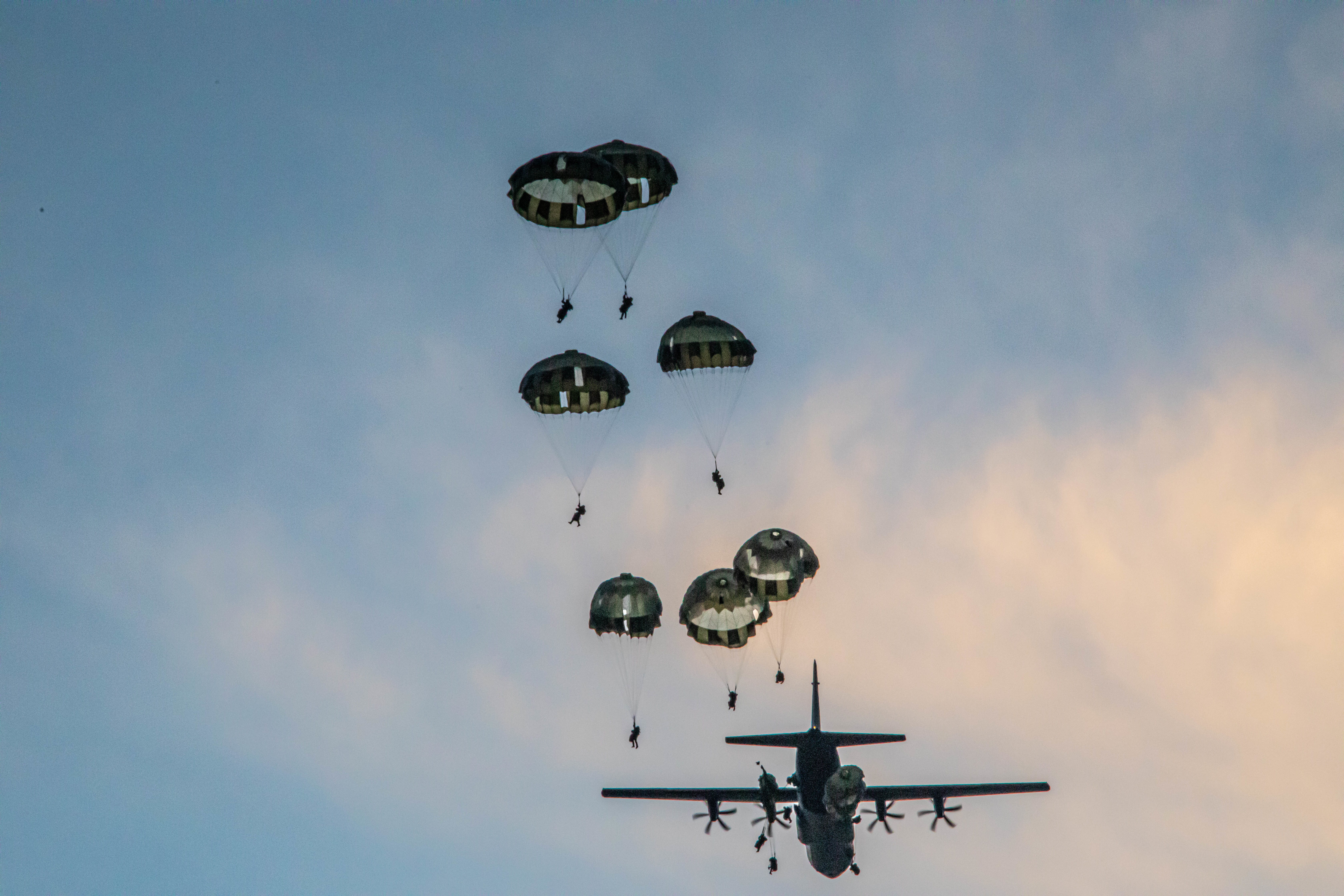 Soldiers from 1st Special Forces Group and members of the Japan Ground Self-Defense Forces Group, complete a joint airborne operation on Andersen Air Force Base, Guam, July 30, 2021. (Pfc. Daniel Proper, 25th Infantry Division/Army)