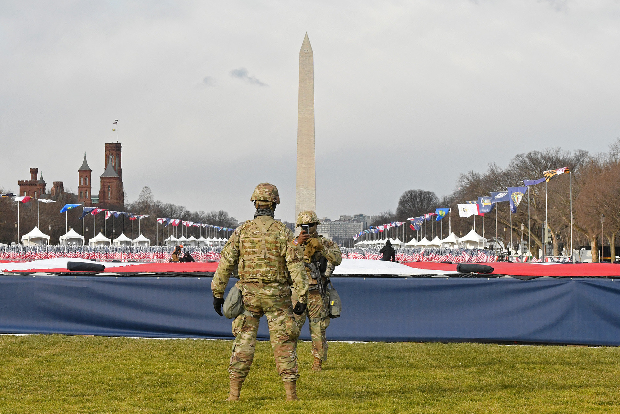 Members of the National Guard stand on the National Mall near the U.S. Capitol before the inauguration of President-elect Joe Biden and Vice President-elect Kamala Harris on Jan. 20, 2021, in Washington. (Stephanie Keith/Getty Images)