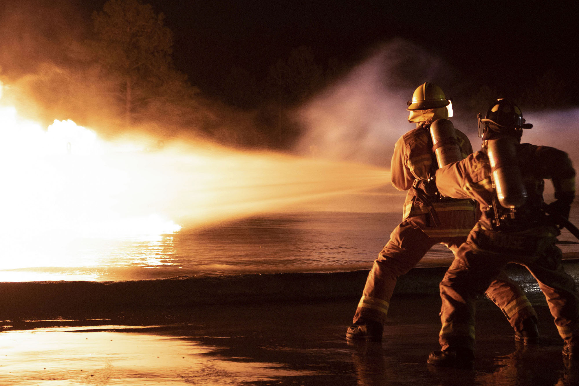 Marine Corps aircraft rescue and firefighting specialists with Headquarters and Headquarters Squadron and Marine Wing Support Squadron 271, conduct live fuel fire burn training on Marine Corps Air Station Cherry Point, N.C., Feb. 3, 2021. (Lance Cpl. Symira Bostic/Marine Corps)