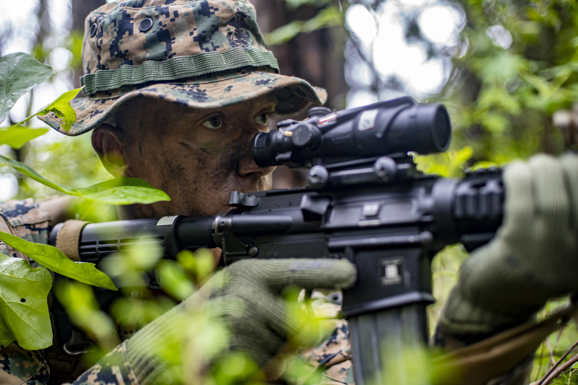Cpl. Geoffrey Daily, a field radio operator with Special Purpose Marine Air-Ground Task Force - Southern Command, provides security during a field exercise at Camp Lejeune, N.C., May 6, 2020. (Sgt. Andy O. Martinez/Marine Corps)