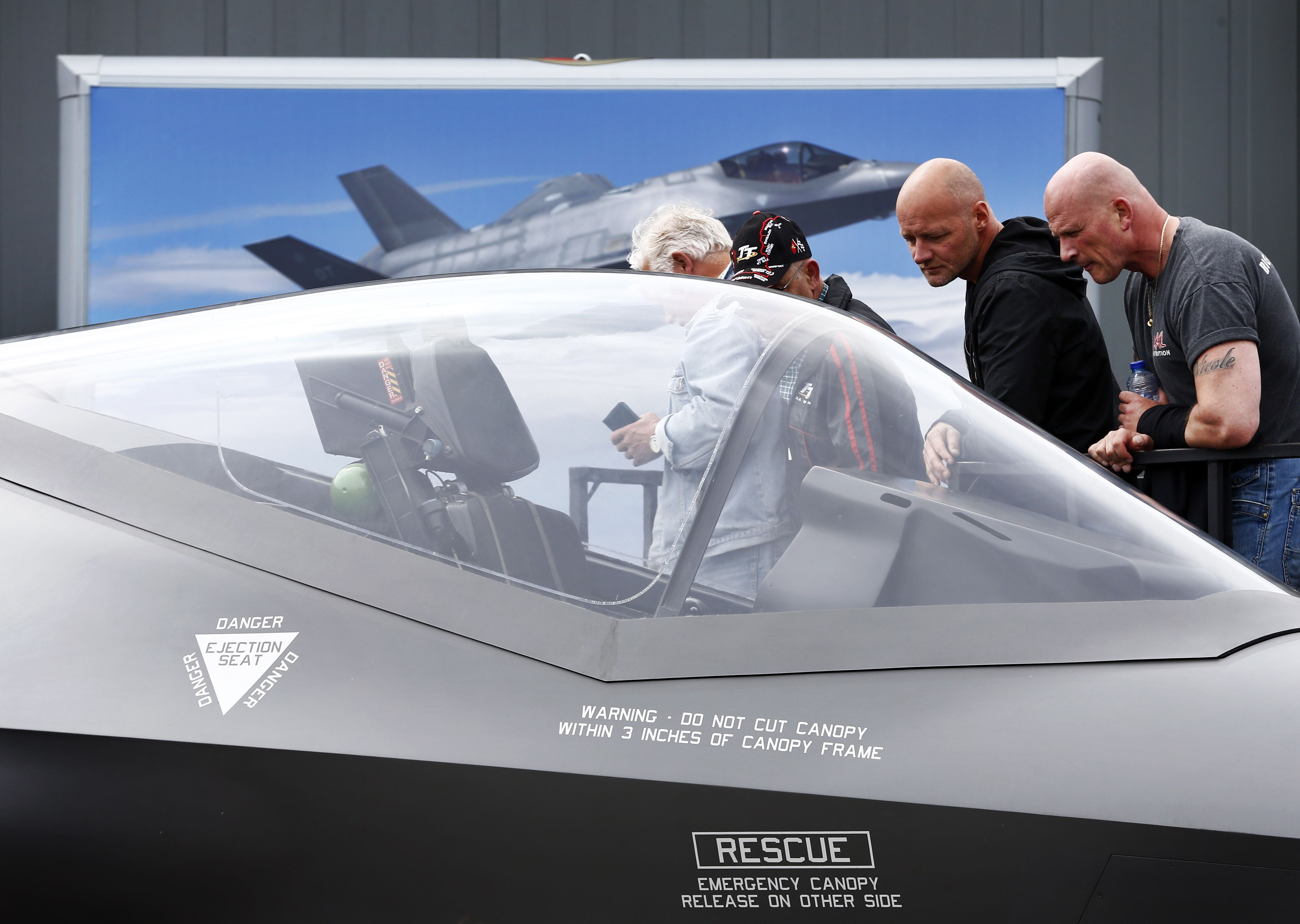 Visitors examine a replica of the Dutch F-35C Joint Striker Fighter during the Dutch Air Force Days at Leeuwarden Air Base on June 10, 2016. (Vincent Jannink/AFP via Getty Images)