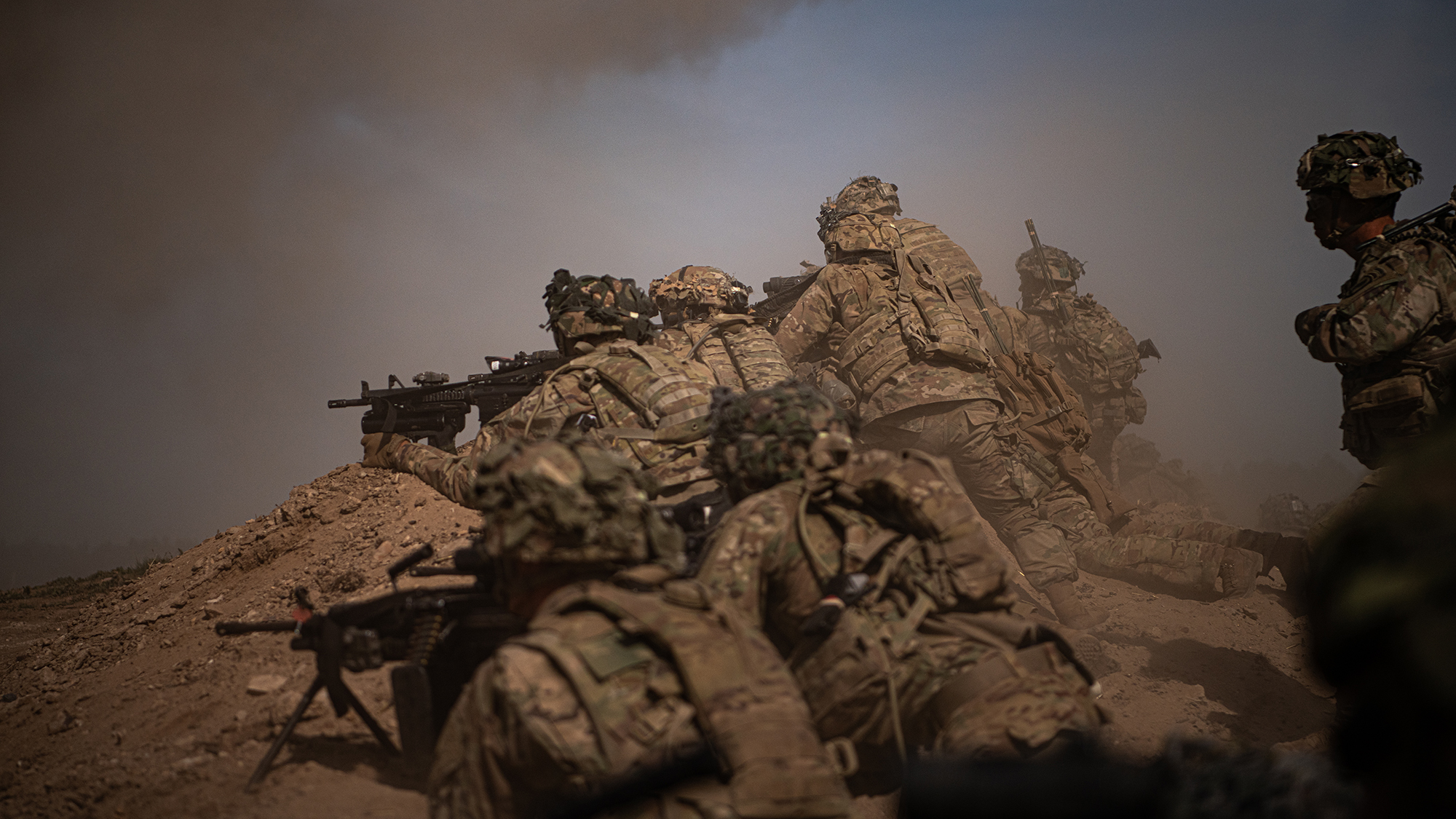 U.S. Army paratroopers move up on a berm to provide security for the assaulting element on July 29, 2020, during a company live fire exercise as part of the 173rd Brigade Field Training Exercise in Grafenwoehr Training Area, Germany from July 17 to Aug. 5, 2020. (Sgt. John Yountz/Army)