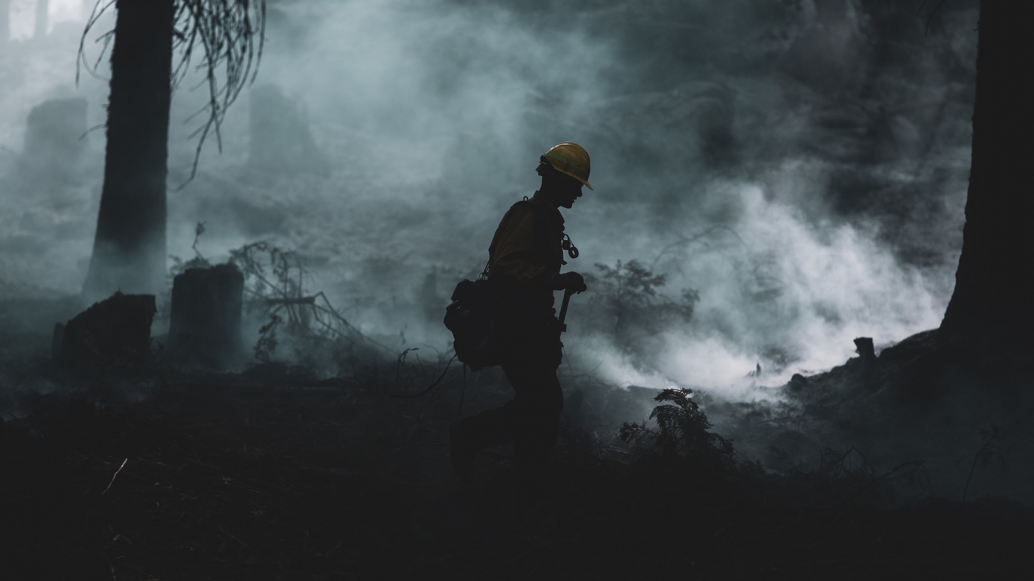 A U.S. Marine assigned to the 7th Engineer Support Battalion, 1st Marine Logistics Group, conducts wildland firefighting operations in O'Neals, Calif., near the Sierra National Forest, Sept. 26, 2020. Approximately 250 Marines from 7th ESB are going to help fight the Creek Fire in central California. (Warrant Officer Eric LaClair/Marine Corps)