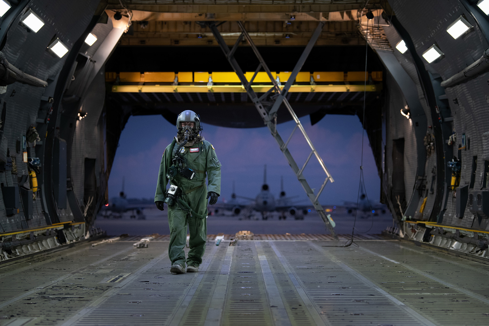 Staff Sgt. Cameron DiMatteo, 22nd Airlift Squadron loadmaster, walks inside a C-5M Super Galaxy during a base exercise Nov. 18, 2020, at Travis Air Force Base, Calif. (Chustine Minoda/Air Force)