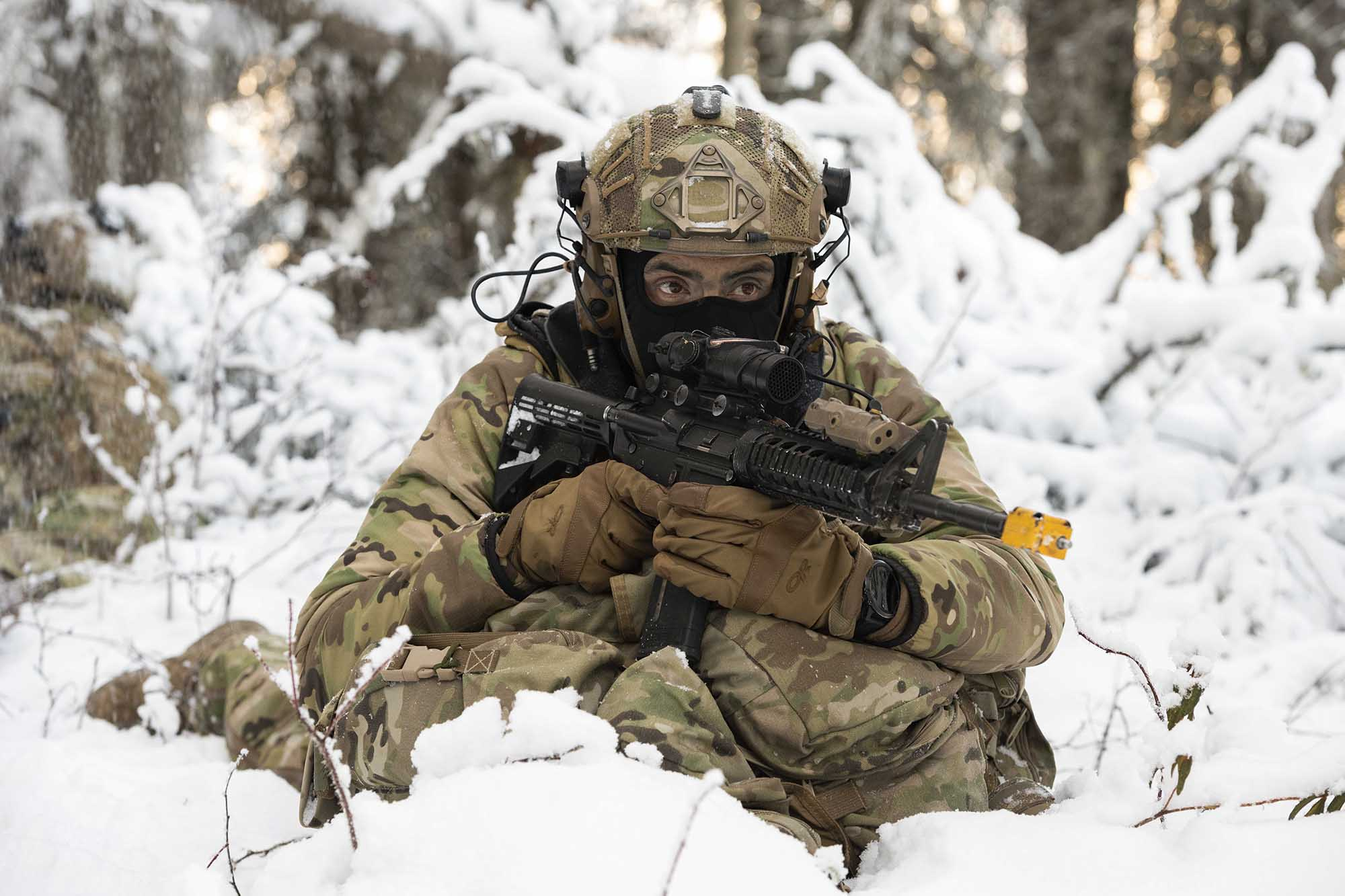 Senior Airman Bryan Guerrero, a tactical air control party apprentice assigned to the 3rd Air Support Operations Squadron, provides security during a patrol halt while conducting small unit training at Joint Base Elmendorf-Richardson, Alaska, Nov. 18, 2020. (Alejandro Pena/Air Force)