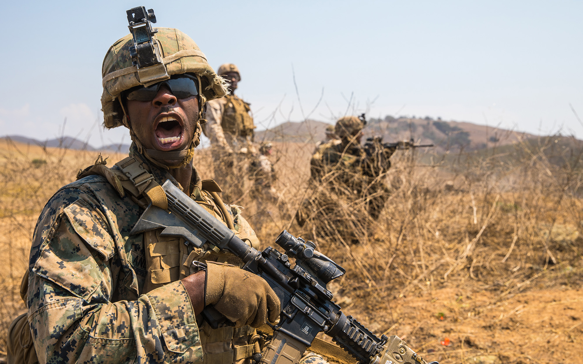 Marine Corps Lance Cpl. Joshua Anderson relays commands to his fire team while conducting offensive operations during the Supersquad 2020 Competition at Marine Corps Base Camp Pendleton, Calif., Aug. 20, 2020. (Staff Sgt. Kyle C. Talbot/Marine Corps)
