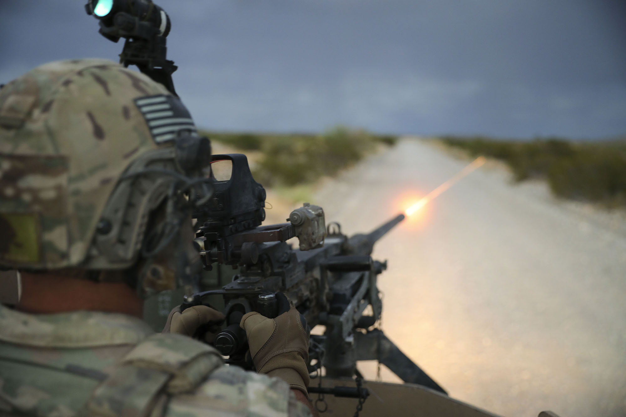 Capt. Matthew Sneddon, 3rd Brigade, 1st Armored Division, fires a vehicle-mounted M2 Browning machine gun on Aug.14, 2020, at Fort Bliss, Texas. (Sgt. Daniel Mariscal/Army)
