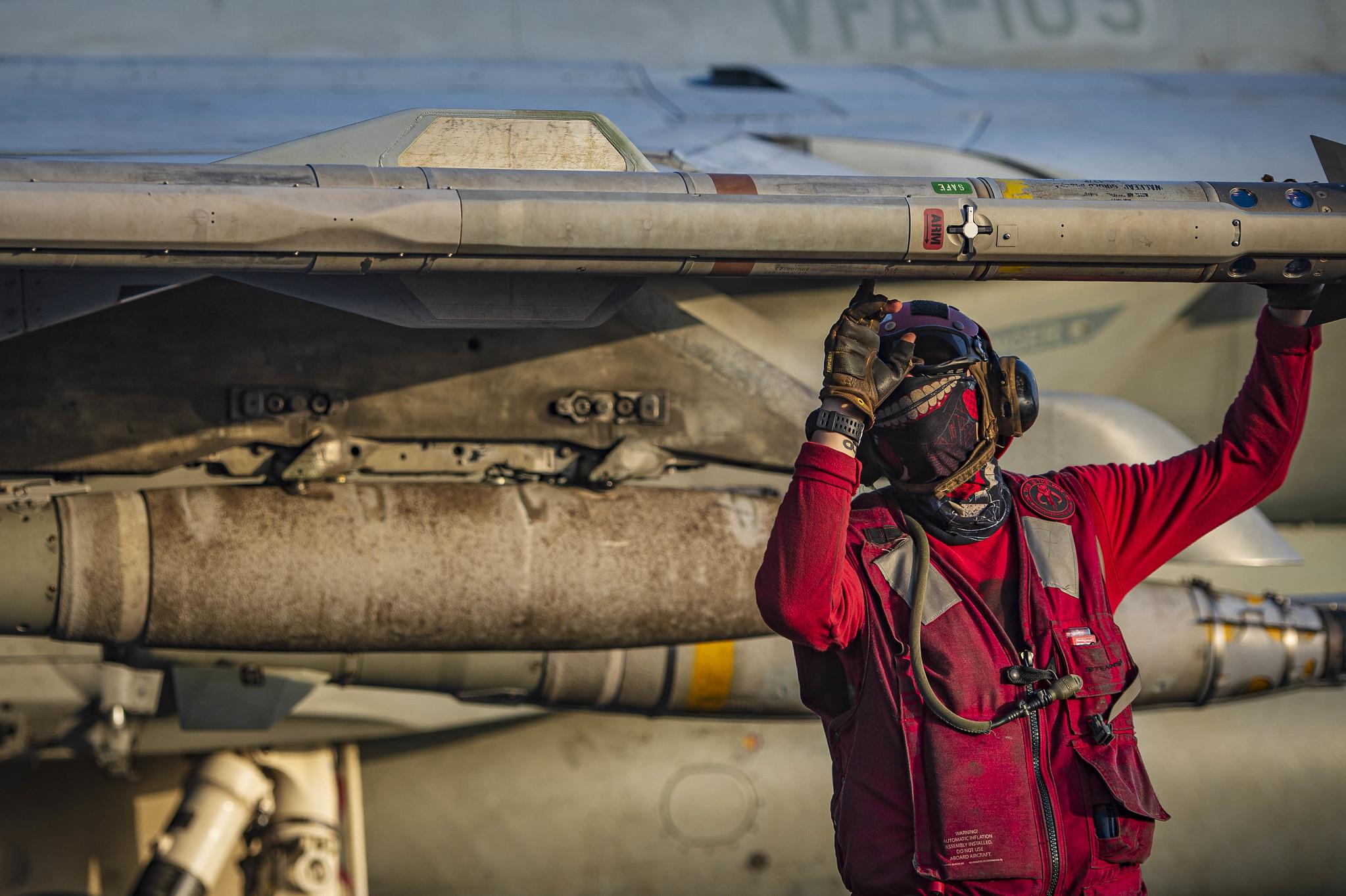 Aviation Ordnanceman Airman Ethan Sauer performs pre-flight ordnance checks on a F/A-18E Super Hornet on May 4, 20121, during flight operations aboard aircraft carrier USS Dwight D. Eisenhower (CVN 69) in the Arabian Sea. (Mass Communication Specialist Seaman Mo Bourdi/Navy)