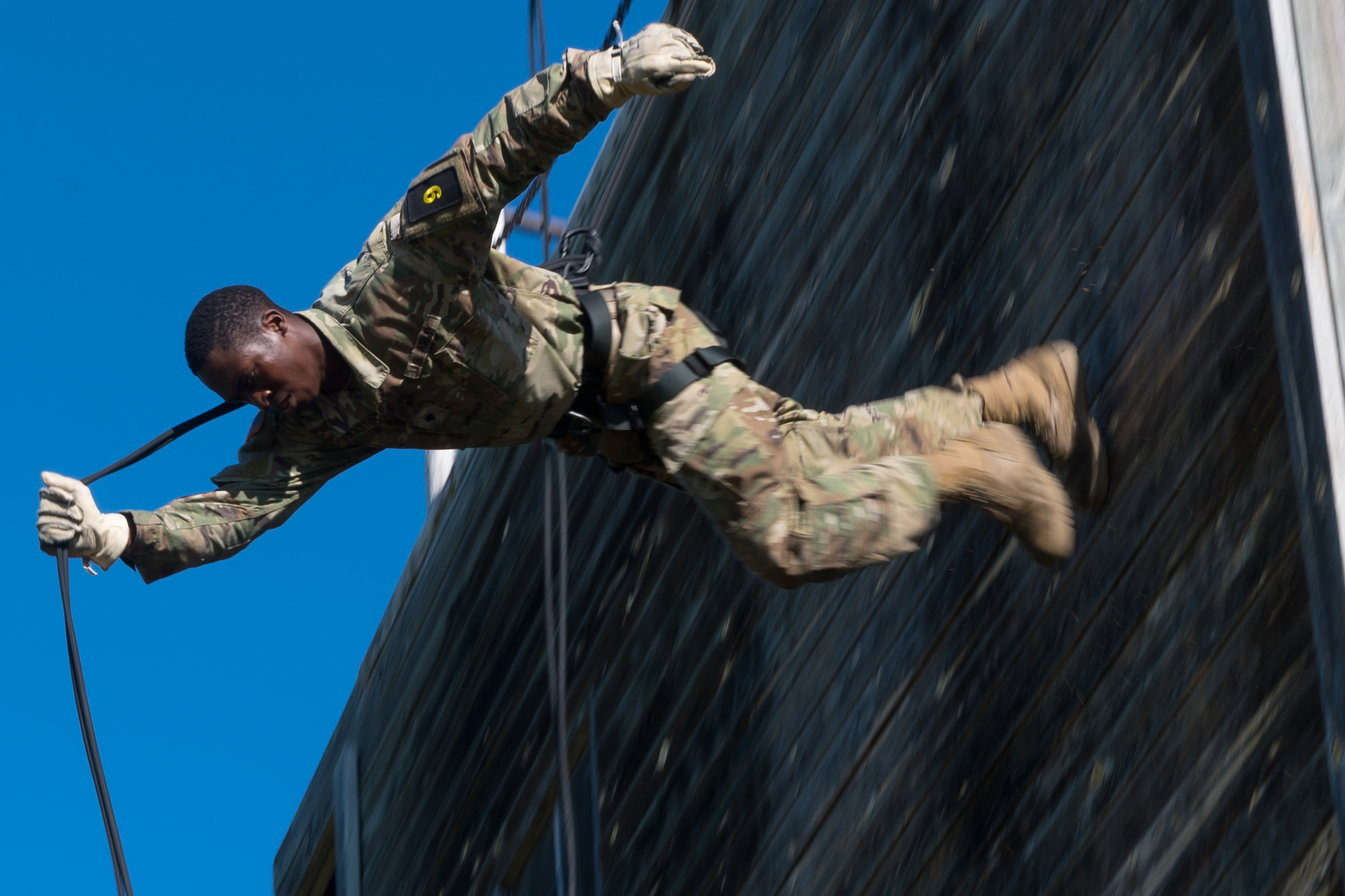 Spc. LeSean Pickstock, 957th Engineer Company, repels down a tower during the North Dakota National Guard Best Warrior Competition at Camp Gilbert C. Grafton, N.D., on Aug. 16, 2020. The competition challenges participants on multiple aspects of Soldier tasks. (Spc. Kristin L. Berg/Army National Guard)
