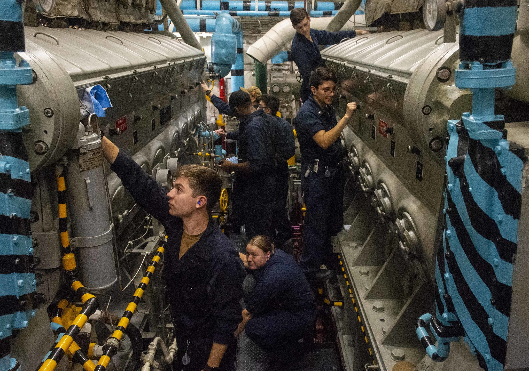Sailors operate an emergency diesel generator in a diesel generator room aboard the aircraft carrier USS Harry S. Truman (CVN 75) during tailored ship's training availability (TSTA) and final evaluation problem (FEP) on June 15, 2021, in the Atlantic Ocean. (Mass Communication Specialist Seaman Tyler Cardoza/Navy)