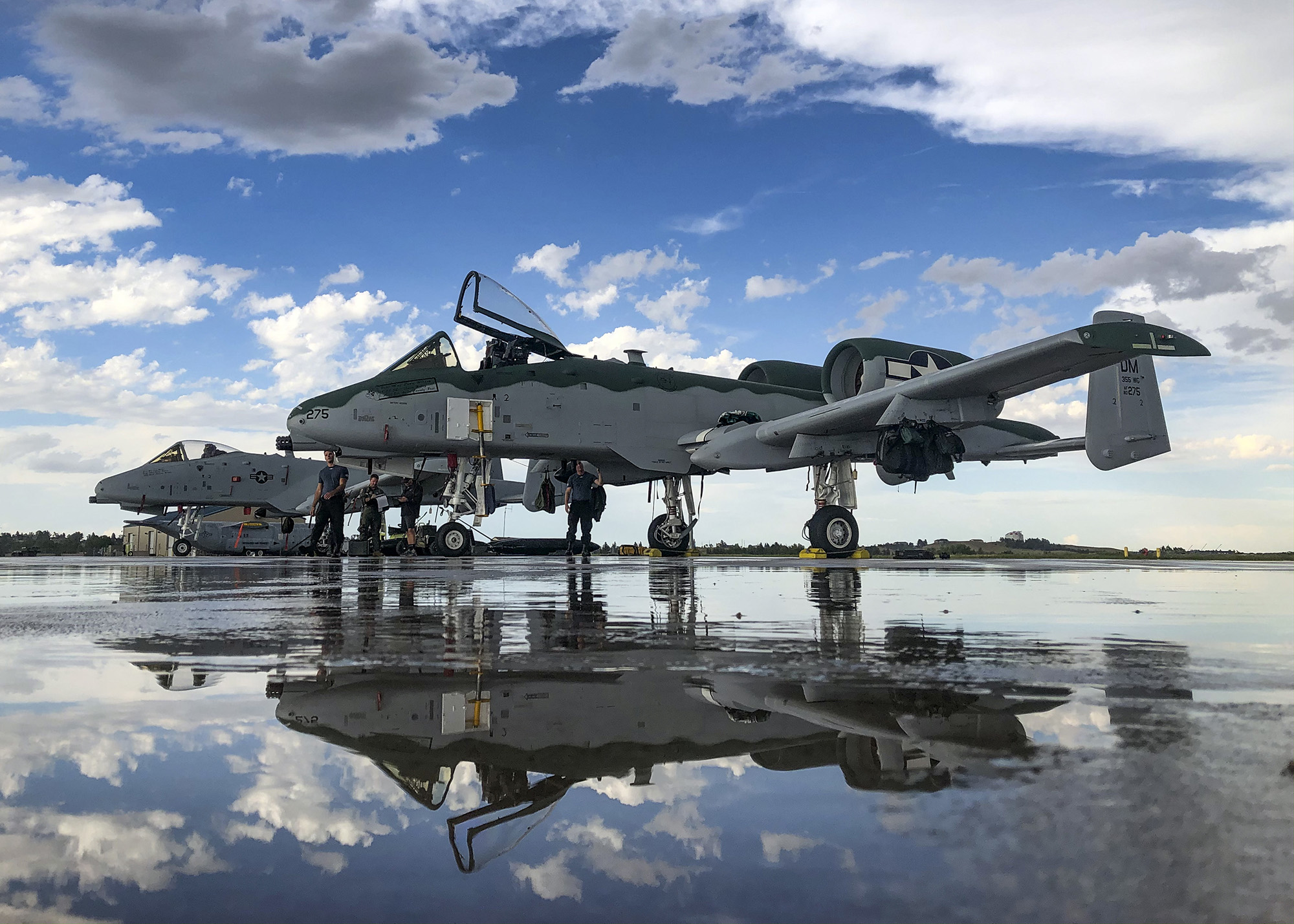A-10 Thunderbolt IIs, assigned to the A-10 Demonstration Team, sit on the flightline at Cheyenne Air National Guard Base, Wyo., July 20, 2020. (Senior Airman Kristine Legate/Air Force)