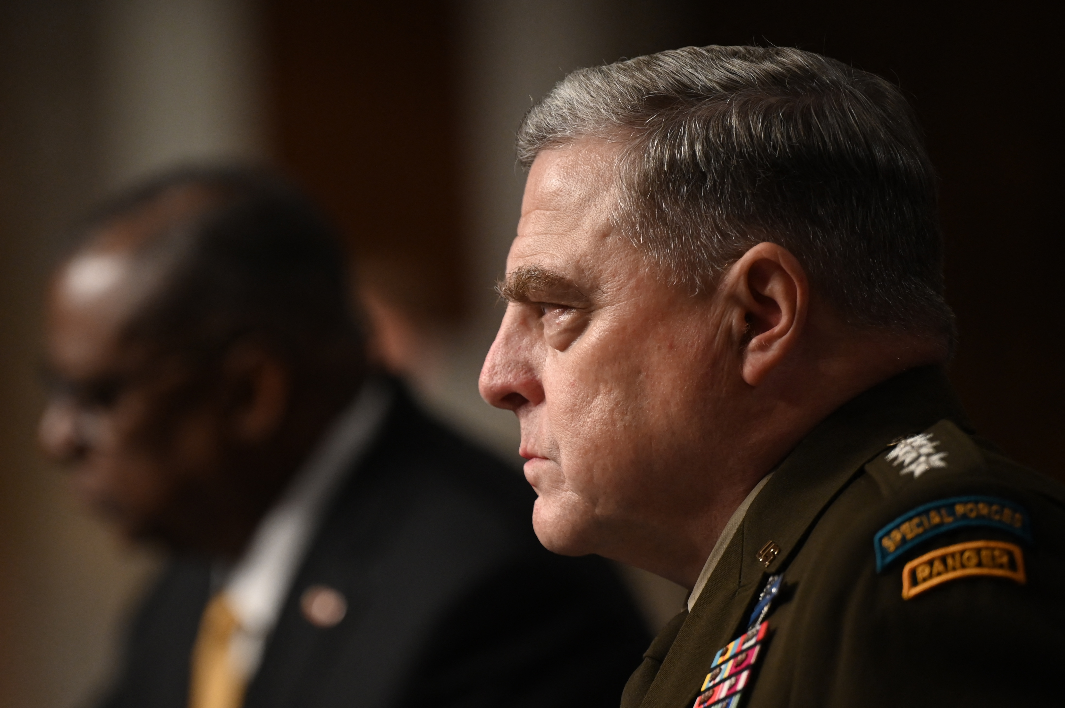 Chairman of the Joint Chiefs of Staff Gen. Mark Milley, right, and Defense Secretary Lloyd Austin attend a Senate Armed Services Committee hearing on June 10, 2021. (Jim Watson/AFP via Getty Images)