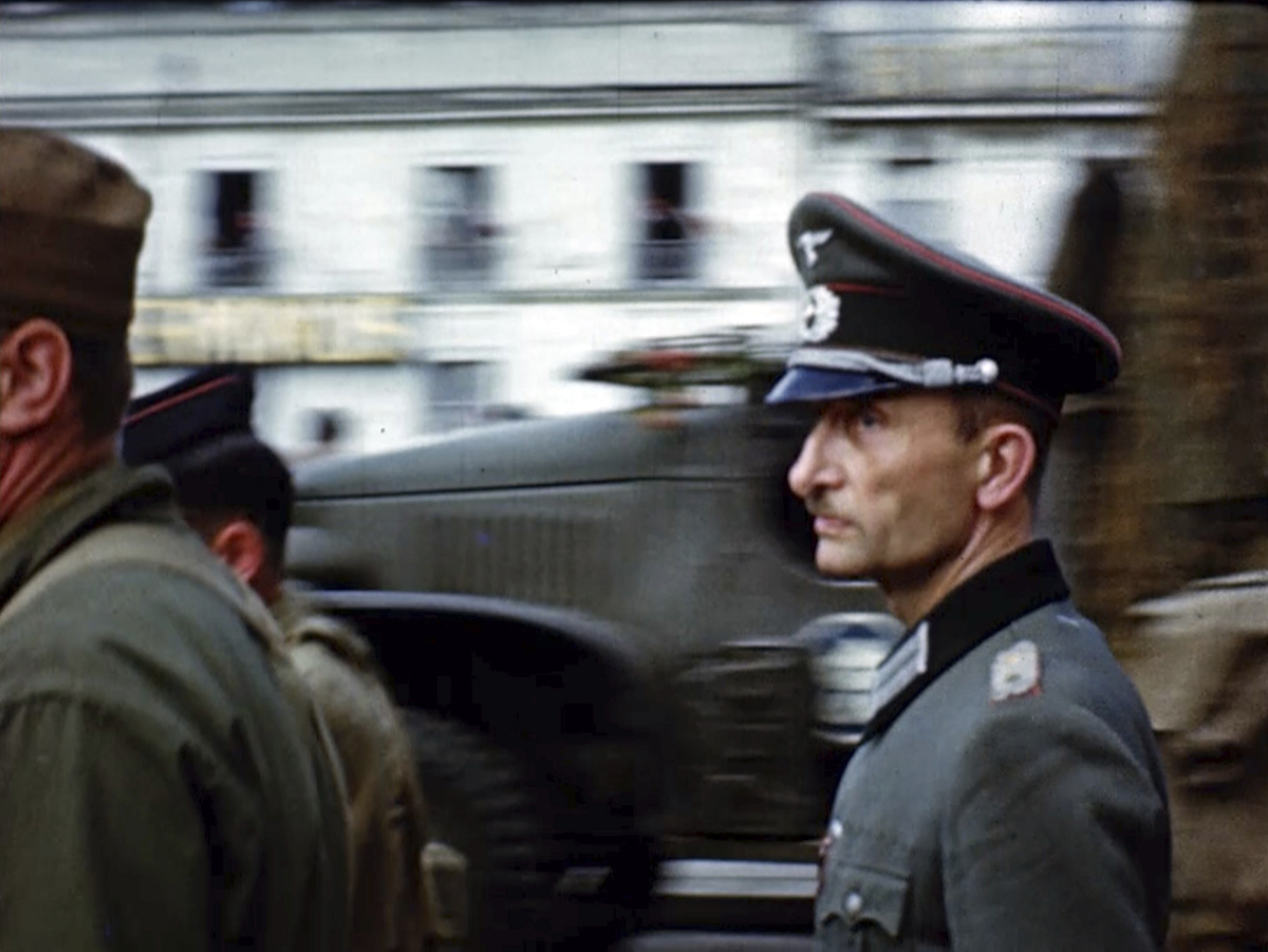 A German officer is escorted by U.S. soldiers after the liberation of Paris in 1944. Seventy-five years later, surprising color images of the D-Day invasion and aftermath bring an immediacy to wartime memories. They were filmed by Hollywood director George Stevens and rediscovered years after his death. (War Footage From the George Stevens Collection at the Library of Congress via AP)
