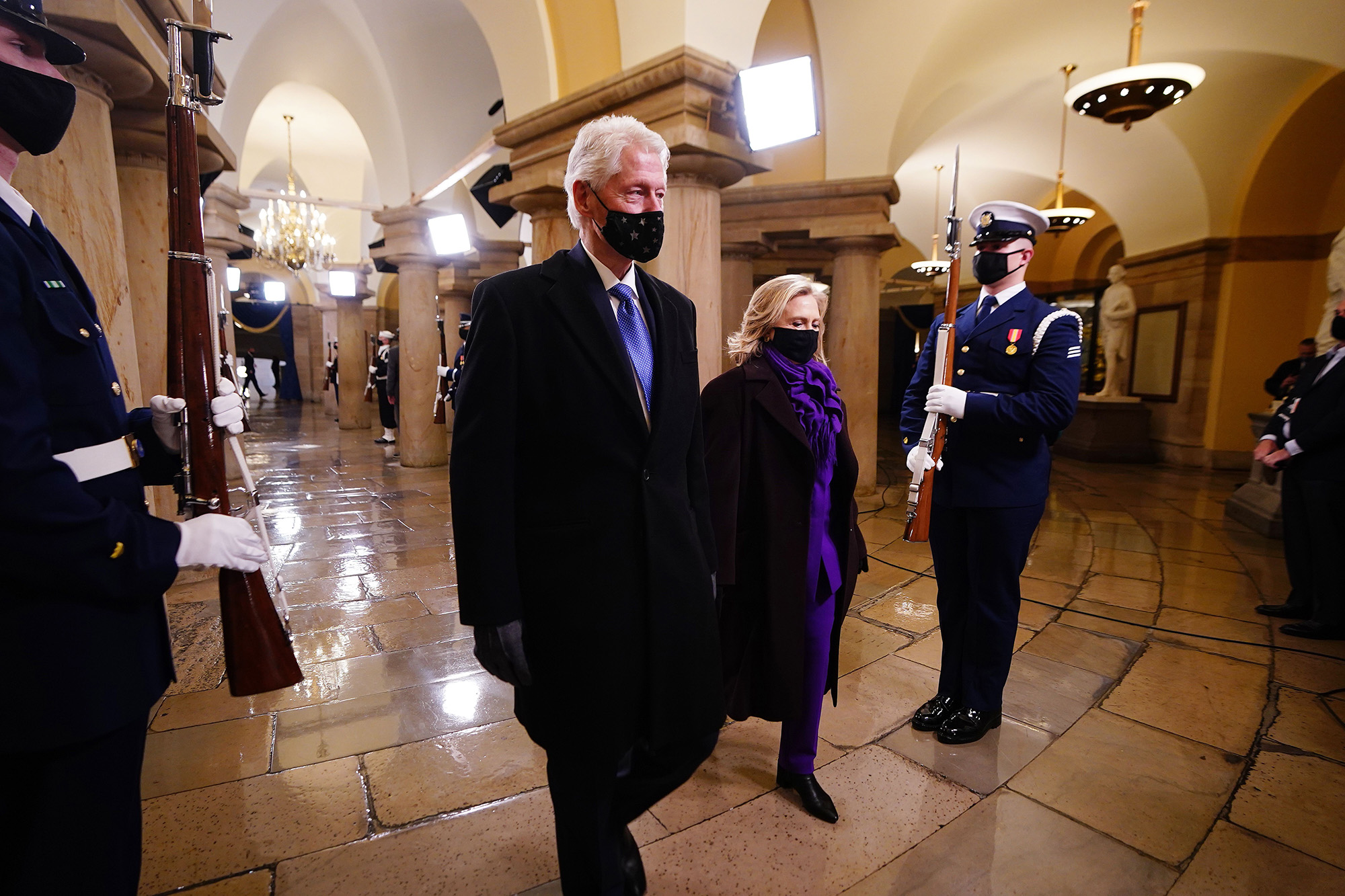 Former President Bill Clinton arrives with former Secretary of State Hillary Clinton before the inauguration of President-elect Joe Biden as the 46th president of the United States on the West Front of the Capitol in Washington on Jan. 20, 2021. (Jim Lo Scalzo/Pool, AFP via Getty Images)