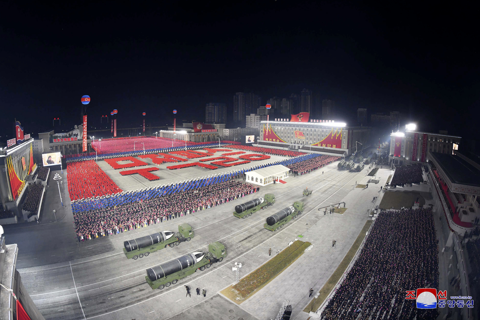 North Korean state TV aired edited footage of a military parade that showed thousands of civilians and troops roaring and fireworks exploding overhead. (Korean Central News Agency/Korea News Service via AP)