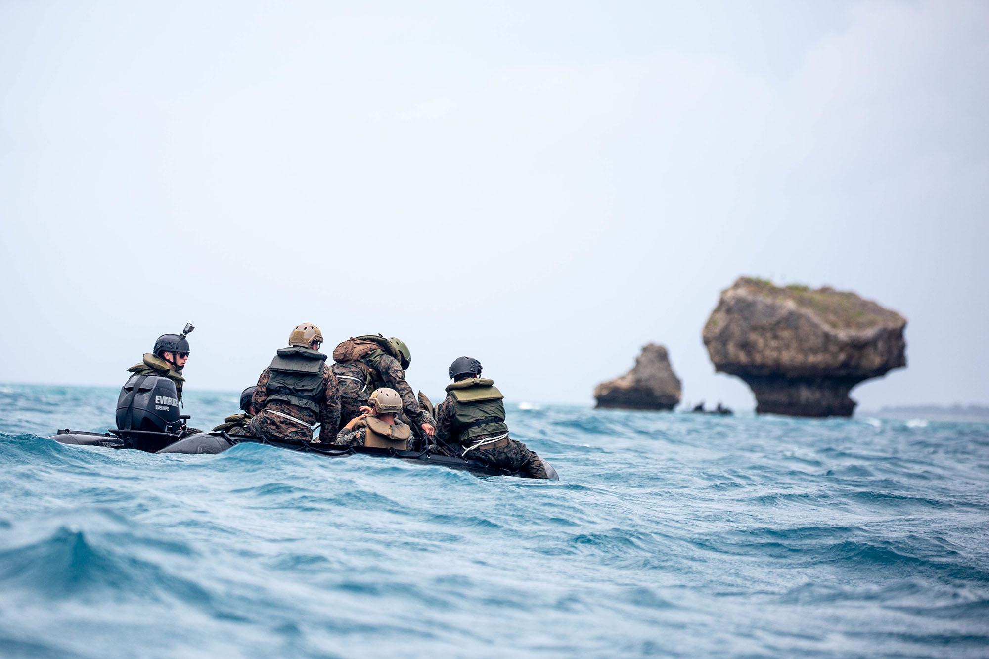 Marines navigate combat rubber raiding craft during small boat tactics training at White Beach Naval Facility in Okinawa, Japan, May 27, 2021. (Sgt. Cody Rowe/Marine Corps)