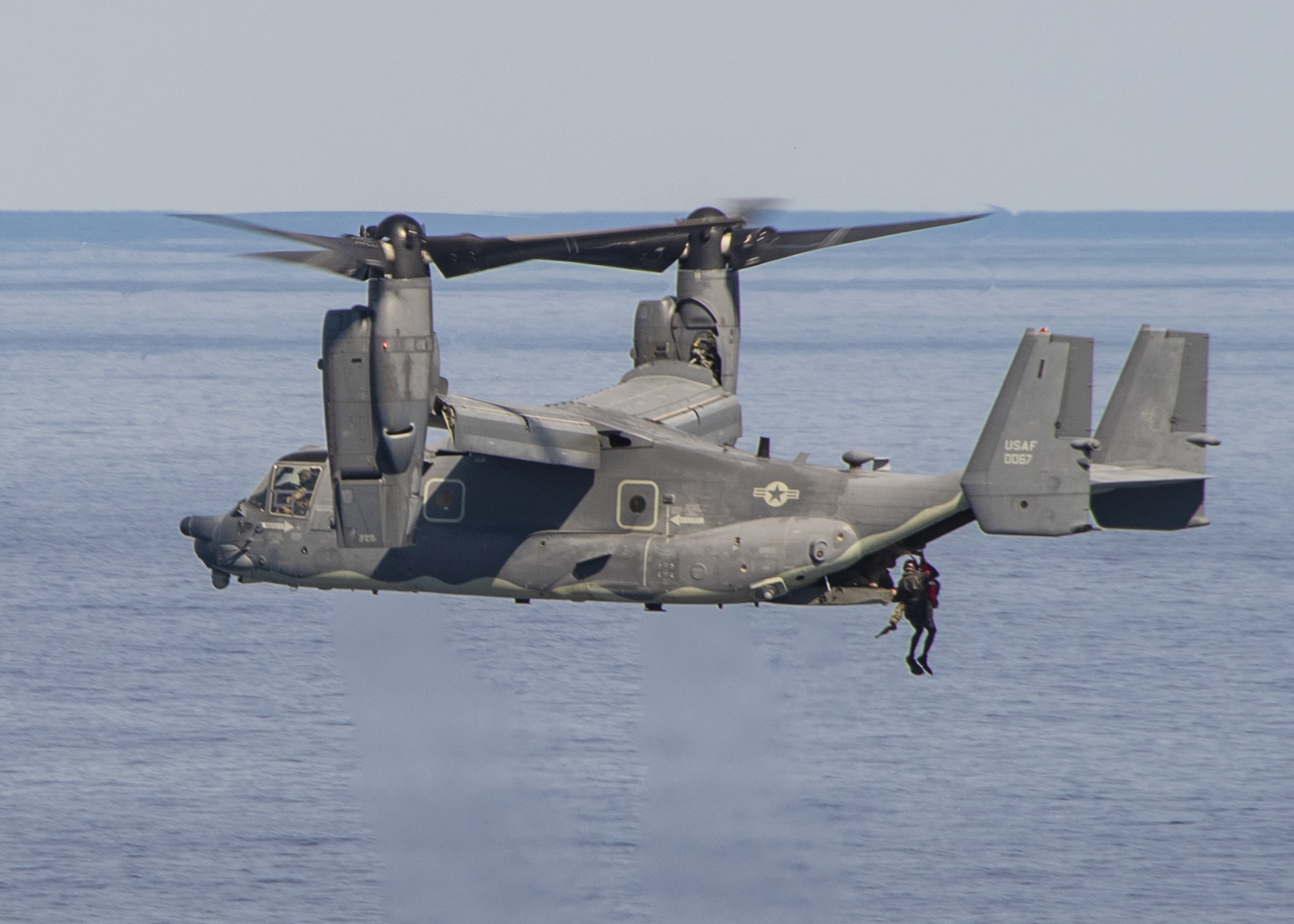 A U.S. Air Force CV-22 Osprey, attached to the 21st Special Operations Squadron operating out of Yokota Air Base, Japan, conducts a search-and-rescue exercise in conjunction with the aircraft carrier USS Ronald Reagan (CVN 76) during Keen Sword 21 on Oct. 28, 2020, in the Philippine Sea. (MC2 Erica Bechard/Navy)