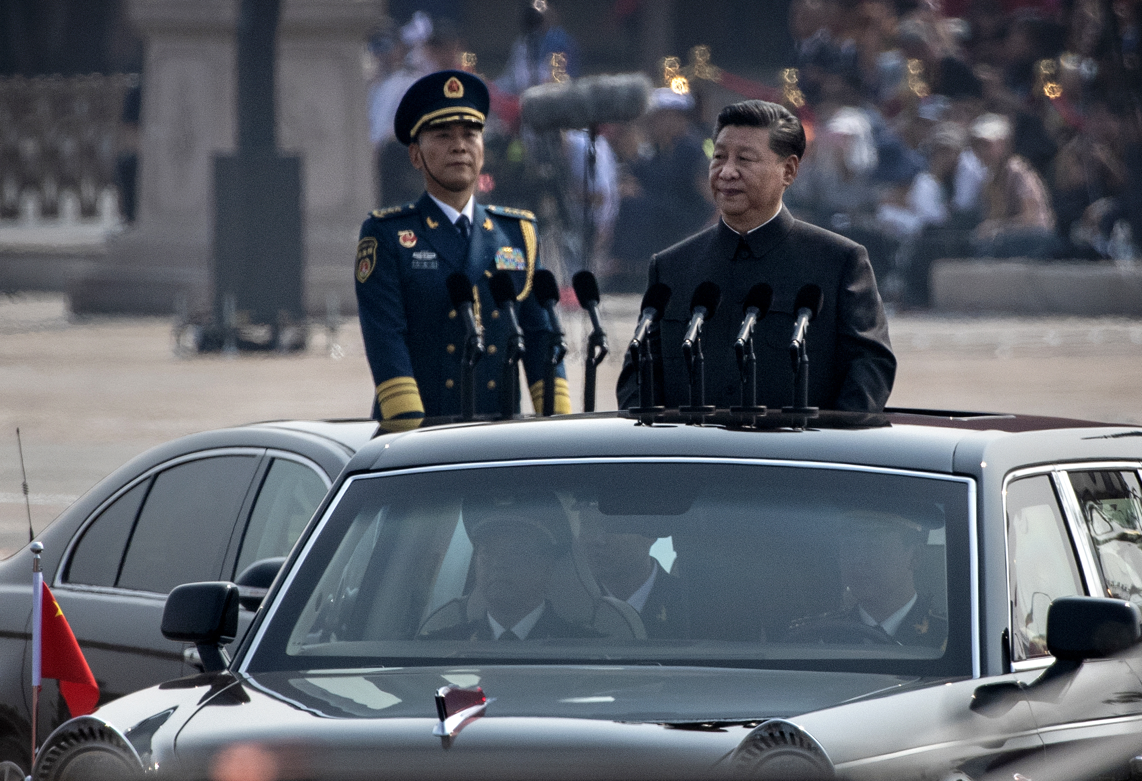 Chinese President Xi Jinping drives in a Hong Qi car after inspecting the troops during a parade to celebrate the 70th anniversary of the founding of the People's Republic of China at Tiananmen Square in 1949, on Oct. 1, 2019, in Beijing, China. (Kevin Frayer/Getty Images)