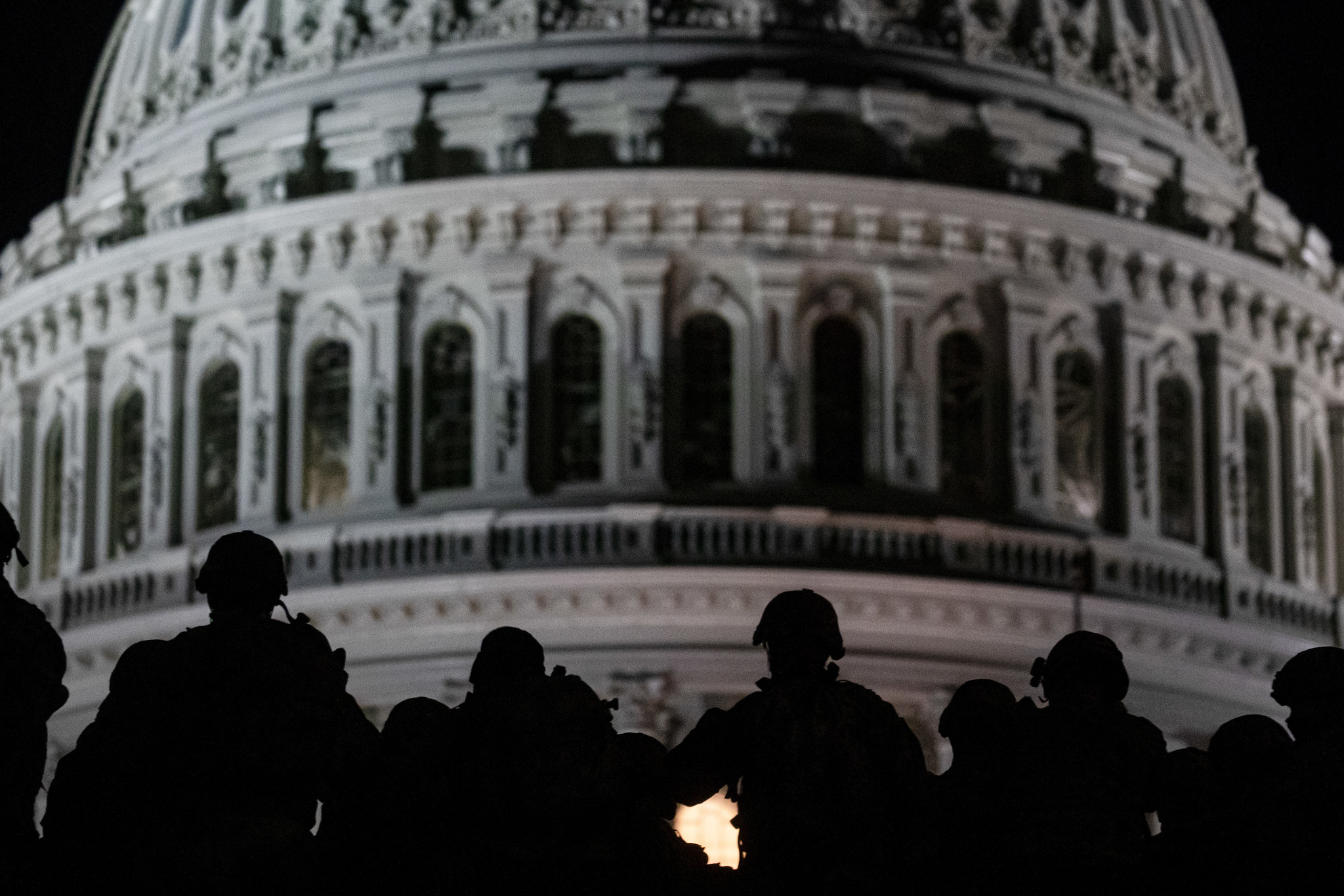 U.S. soldiers with the Virginia National Guard listen to a squad leader briefing after arriving near the Capitol in Washington on, Jan. 13, 2021. (Master Sgt. Matt Hecht/Air National Guard)