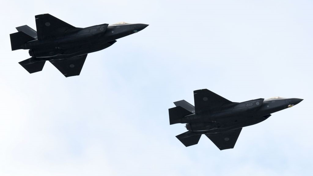 F-35 fighter aircraft from the Japan Air Self-Defense Force take part in a military review at the Ground Self-Defence Force's Asaka training ground in Asaka, Saitama prefecture on October 14, 2018. (KAZUHIRO NOGI/AFP/Getty Images)