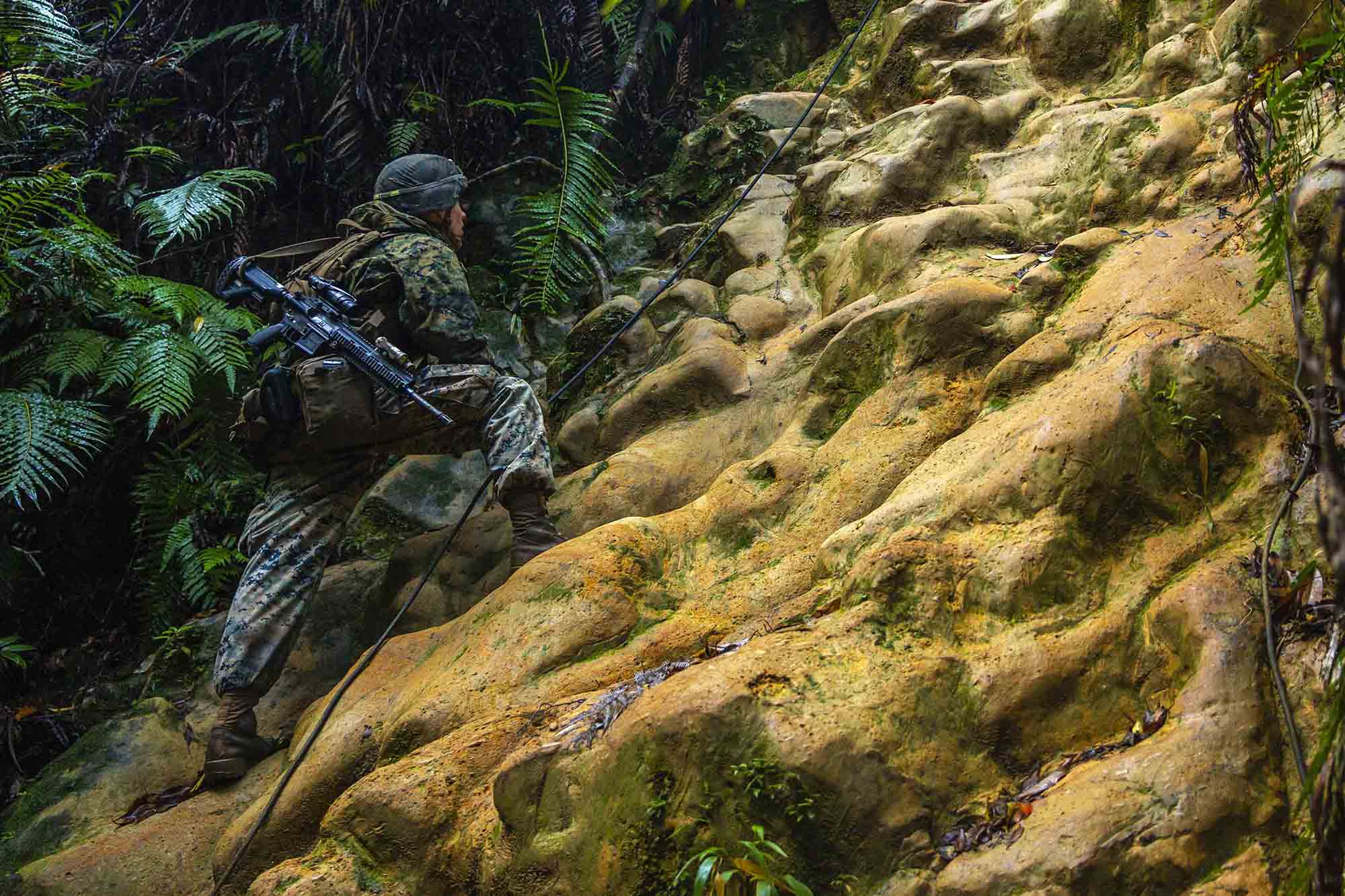 U.S. Marine Corps Lance Cpl. Ethan Sawyer conducts route reconnaissance during the 3d Marine Division Rifle Squad Competition at Camp Gonsalves, Okinawa, Japan, Jan. 11, 2021. (Lance Cpl. Scott Aubuchon/Marine Corps)