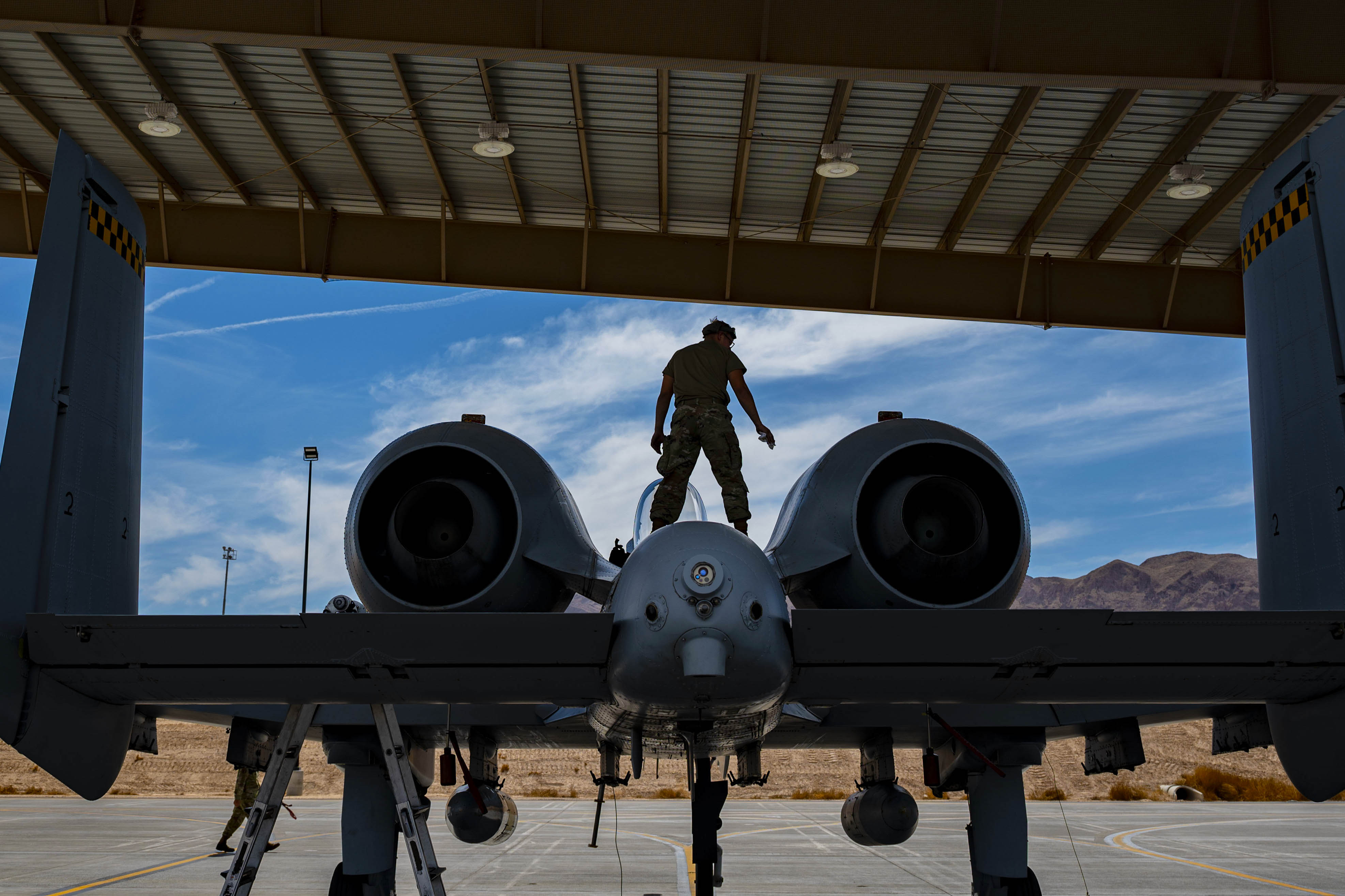 Airman 1st Class Zane Campbell, a tactical aircraft maintainer assigned to the 757th Aircraft Maintenance Squadron, performs maintenance on an A-10 Warthog at Nellis Air Force Base, Nevada, June 26. (Airman 1st Class Zachary Rufus/Air Force)