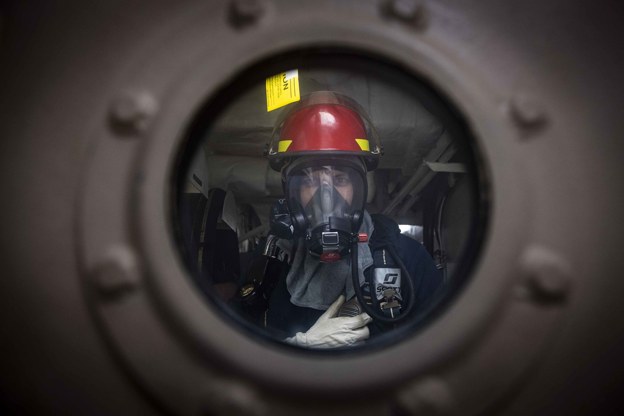 Chief Gunner's Mate Ken Marsh stands by as scene leader during a damage control drill aboard the Freedom-variant littoral combat ship USS Detroit (LCS 7) on July 3, 2020, in the Caribbean Sea. (MC2 Anderson W. Branch/Navy)