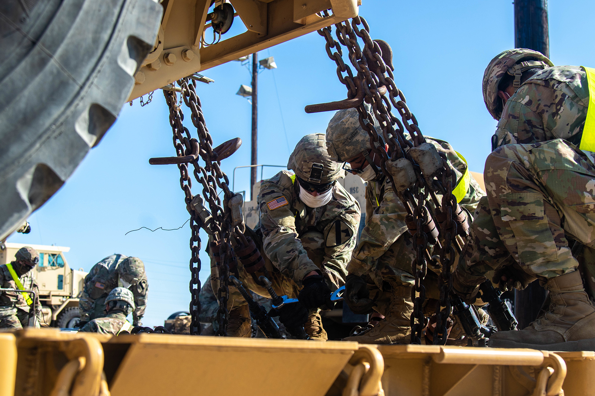 Motor Transport Operators with 1st Cavalry Division Sustainment Brigade unfasten a vehicle from a rail-cart during railhead operations, Fort Hood, Texas, June 8, 2020. (Sgt. Calab Franklin/Army)