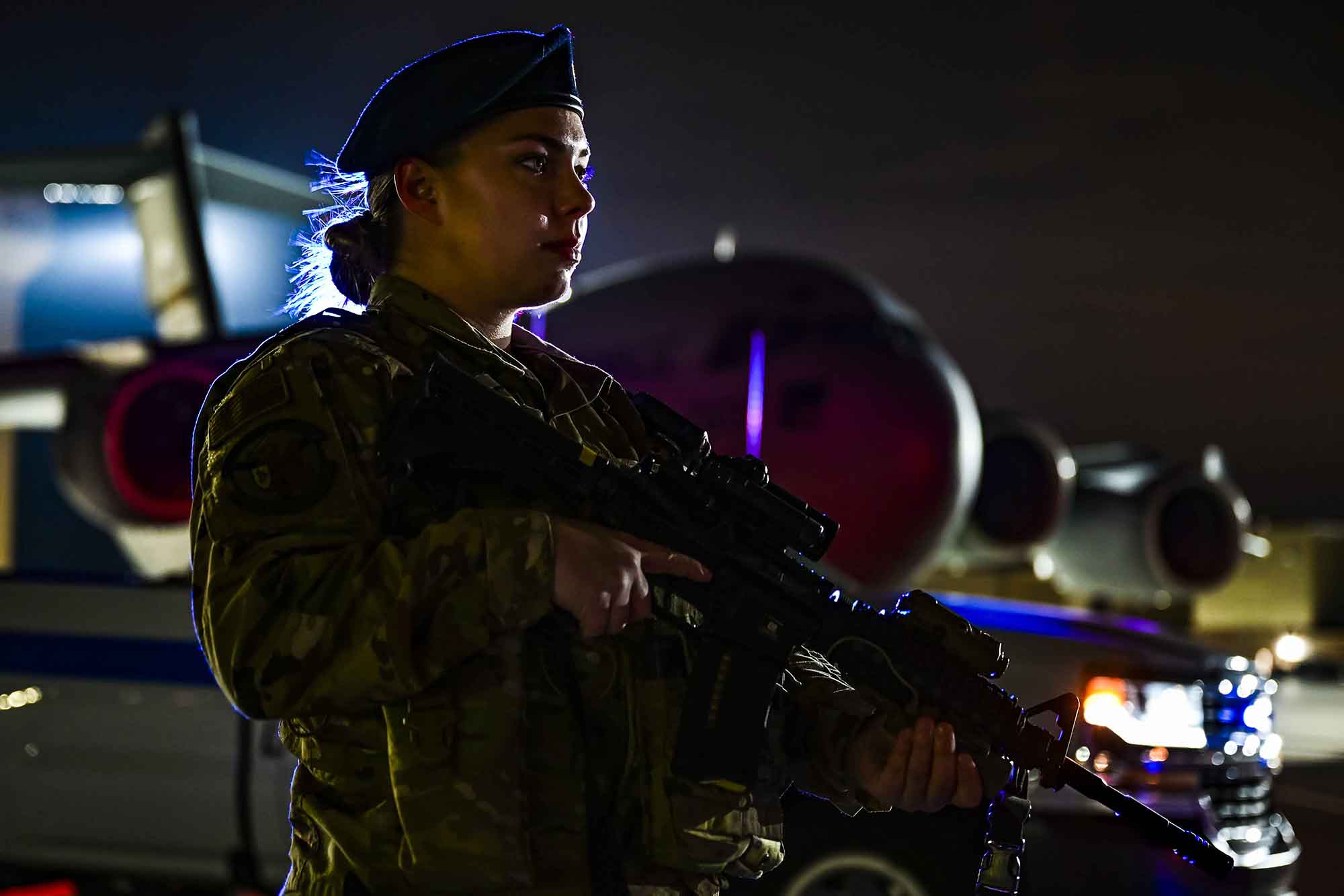 Senior Airman Alexis Williams, 911th Security Forces Squadron patrolman, stands guard in front of a C-17 Globemaster III during a routine training exercise at the Pittsburgh International Airport Air Reserve Station, Pa., Jan. 19, 2021. (Joshua J. Seybert/Air Force)