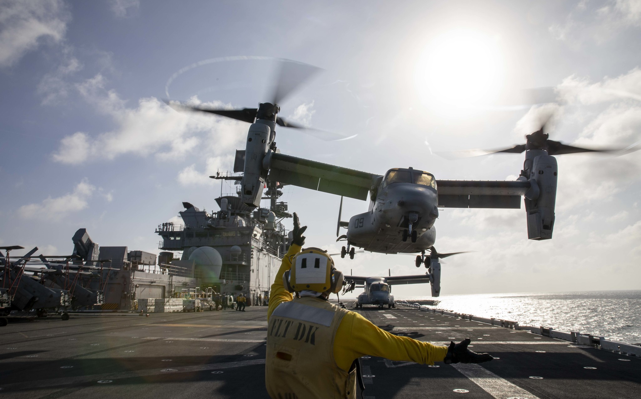 Aviation Boatswain's Mate (Handling) 2nd Class Skyler Campbell directs a Marine Corps MV-22 Osprey on Jan. 23, 2021, during takeoff from the amphibious assault ship USS Makin Island (LHD 8) in the Indian Ocean. (MC3 Aaron Sperle/Navy)