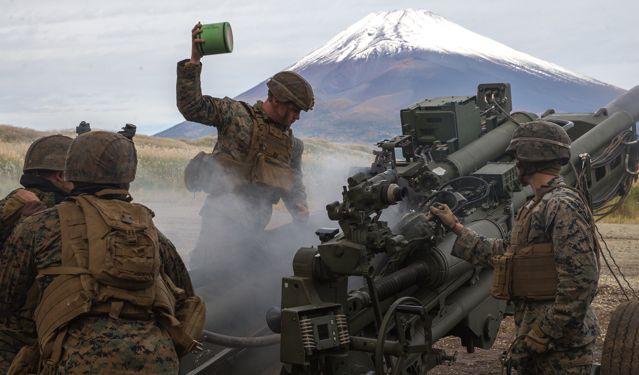 U.S. Marines prepare to fire an M777A2 155mm Howitzer as a part of the Artillery Relocation Training Program 20.3 at Combined Arms Training Center, Camp Fuji, Japan, Oct. 20, 2020. (Cpl. Savannah Mesimer/Marine Corps)