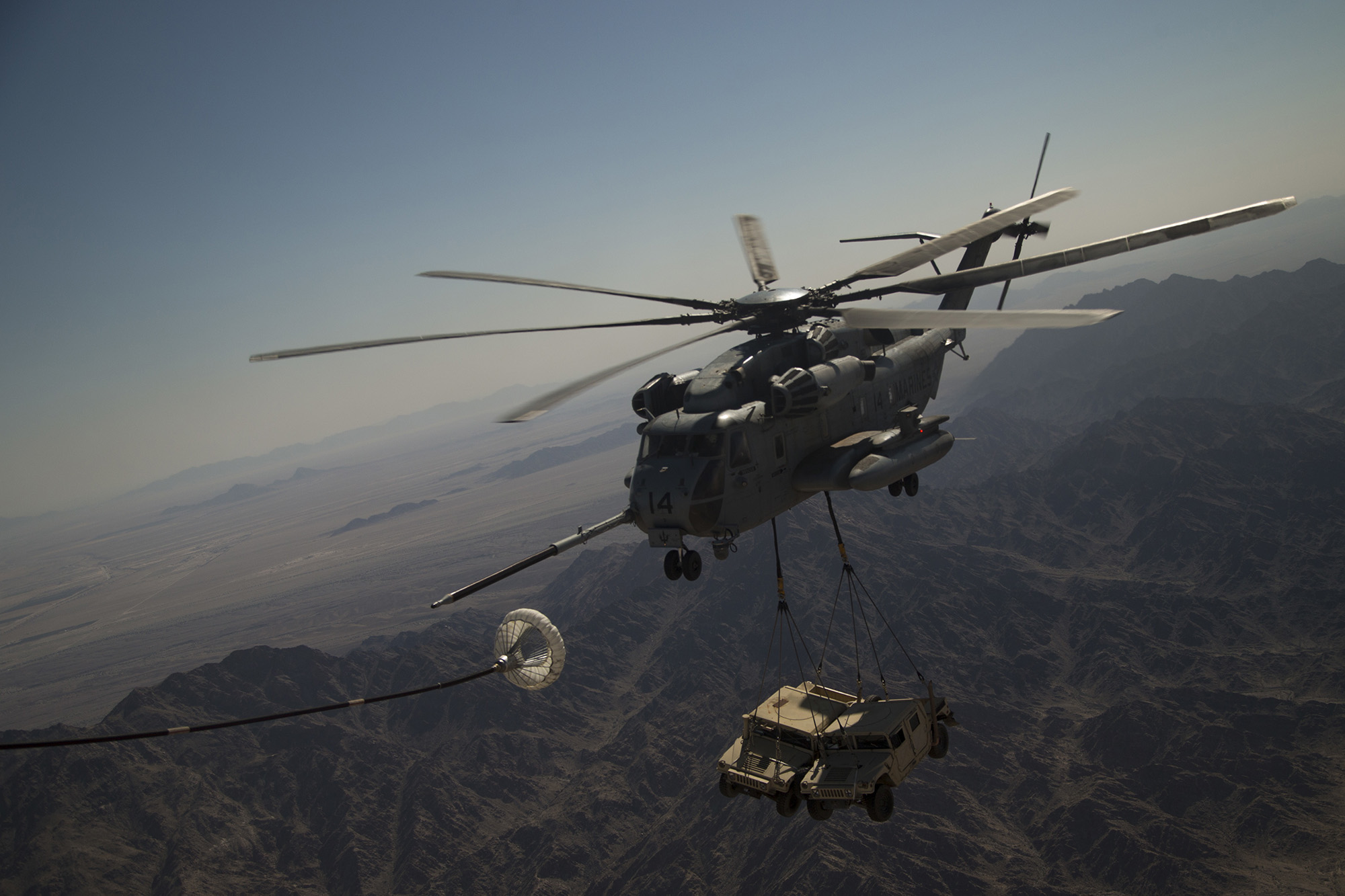 A U.S. Marine Corps CH-53E Super Stallion executes an air-to-air refuel during a heavy lift exercise in support of Weapons and Tactics Instructor (WTI) course 2-21, near Yuma, Ariz., March 31, 2021. (Lance Cpl. Camille Polete/Marine Corps)