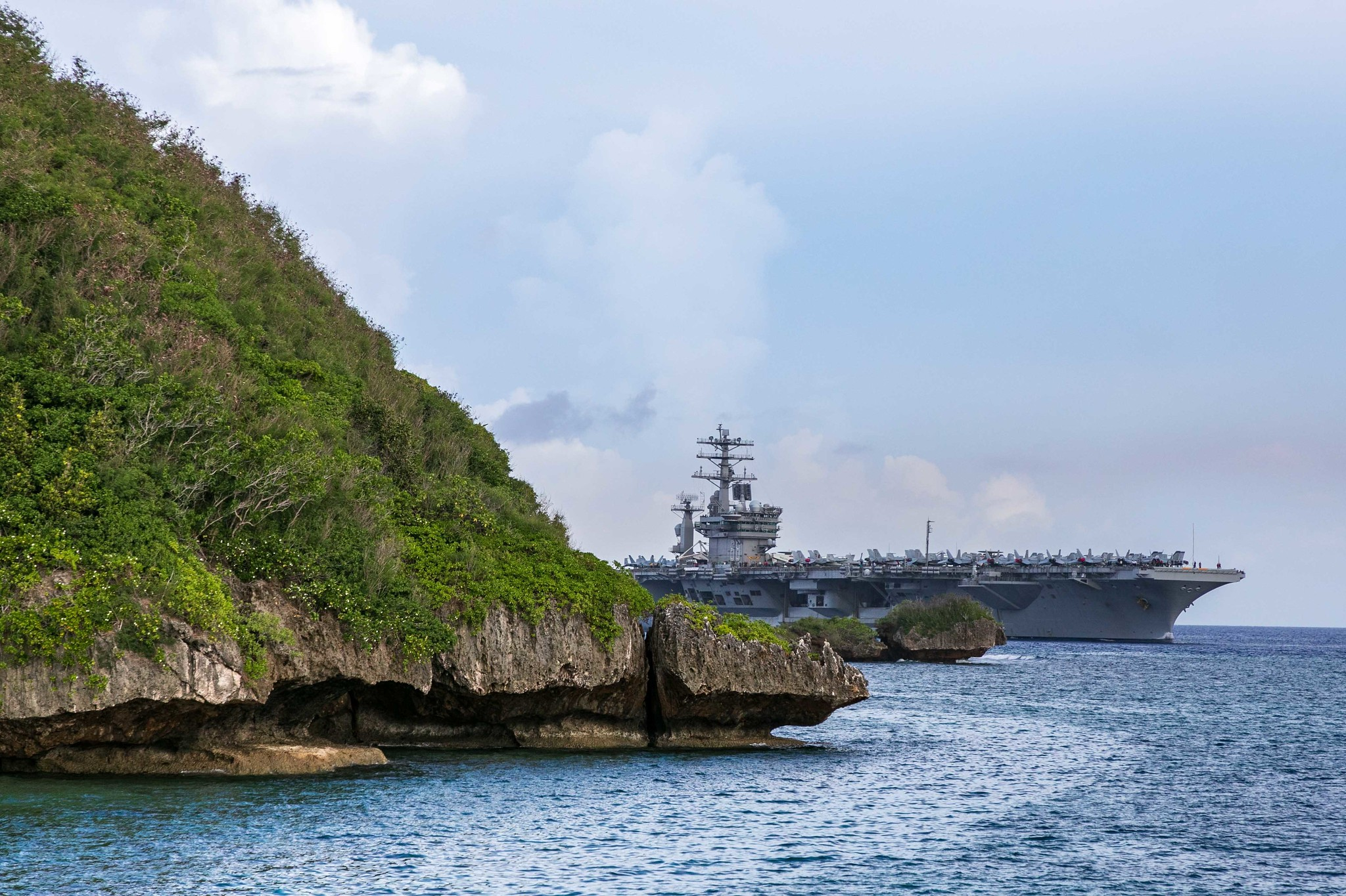 The aircraft carrier USS Nimitz (CVN 68) passes Point Udall as it enters Apra Harbor on June 24, 2020, prior to mooring at Naval Base Guam for a scheduled port visit. (Chief Mass Communication Specialist Matthew R. White/Navy)