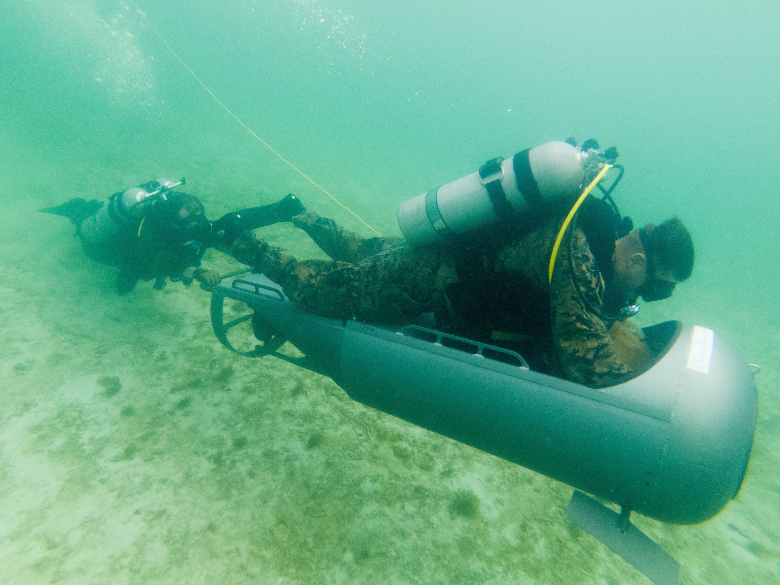 Marines with Force Reconnaissance Company, 3rd Reconnaissance Battalion, 3rd Marine Division, complete an open circuit dive during a Diver Propulsion Device certification course at Camp Schwab, Okinawa, Japan, June 23, 2020. (Lance Cpl. Jackson Dukes/Marine Corps)