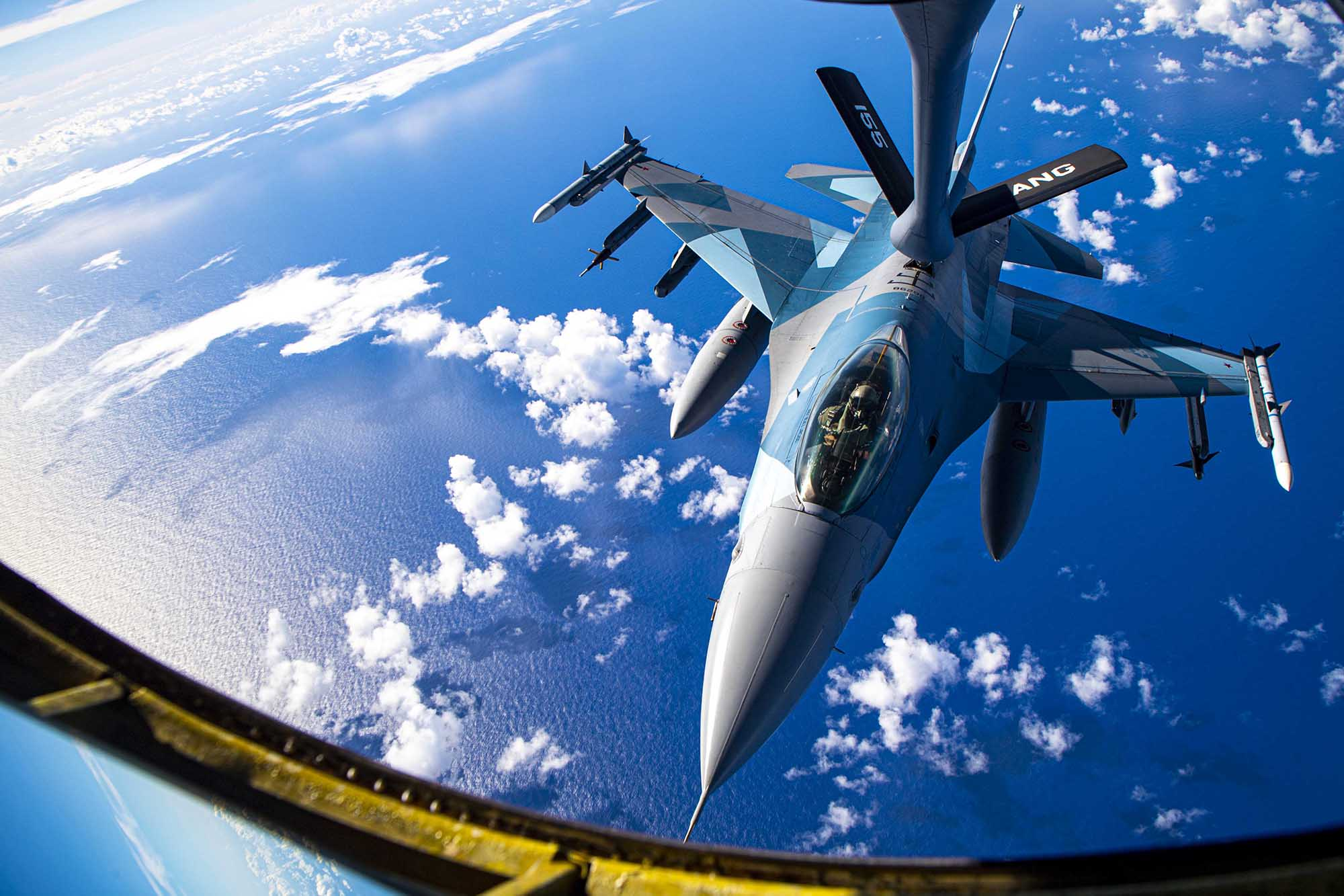 An Air Force F-16 Fighting Falcon conducts an aerial refueling with an Air Force KC-135 Stratotanker during exercise Cope North 21 near Andersen Air Force Base, Guam, Feb. 18, 2021. (Senior Airman Duncan C. Bevan/Air Force)