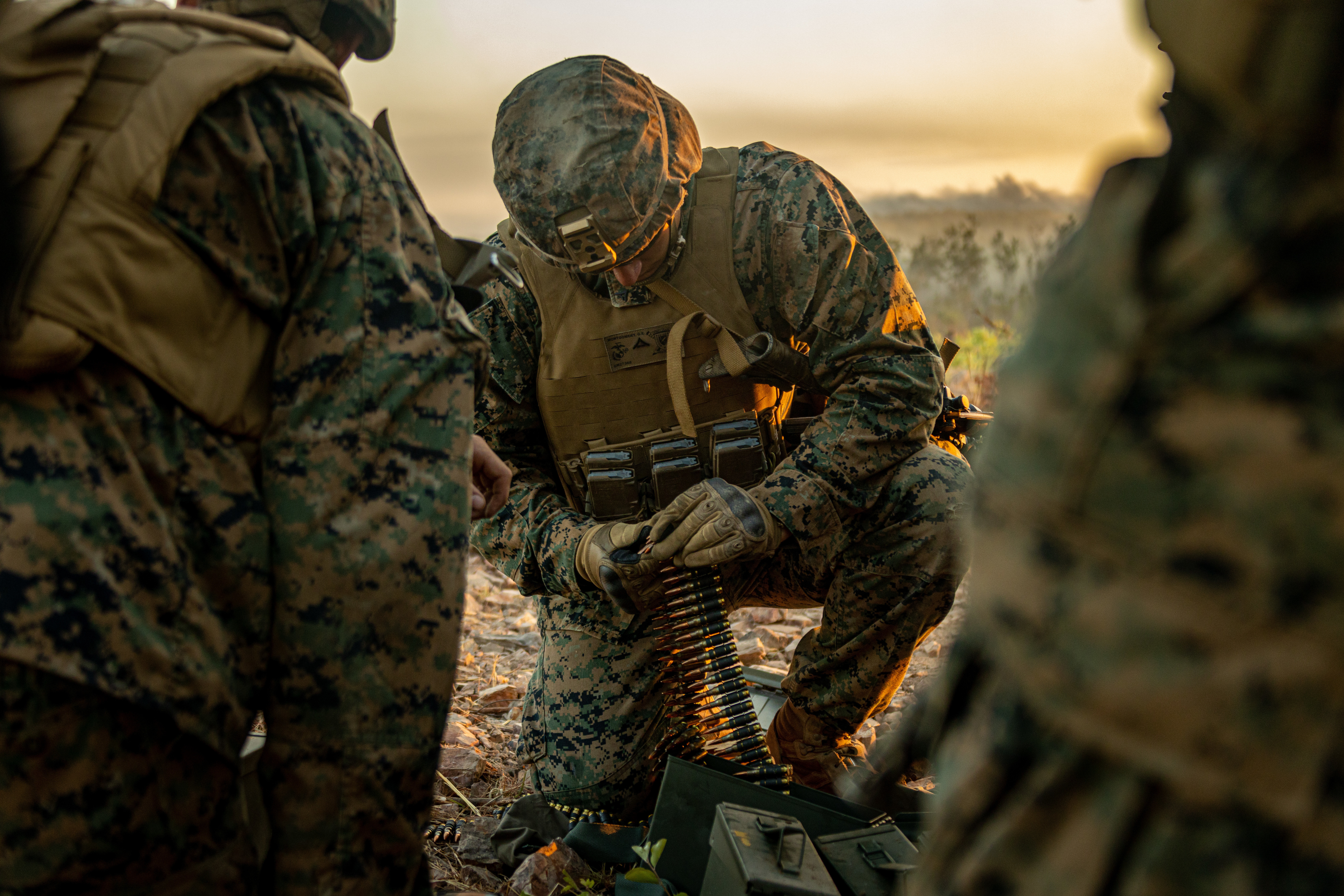 Marine Lance Cpl. Gavin Montgomery, a machine gunner in Combined Anti-armor Team Blue Platoon, with Weapons Company, 1st Battalion, 7th Marine Regiment (Reinforced), Marine Rotational Force–Darwin, prepares ammunition during exercise Southern Jackaroo at Mount Bundey Training Area, NT, Australia, June 23. (Cpl. Sarah Taggett/Marine Corps)