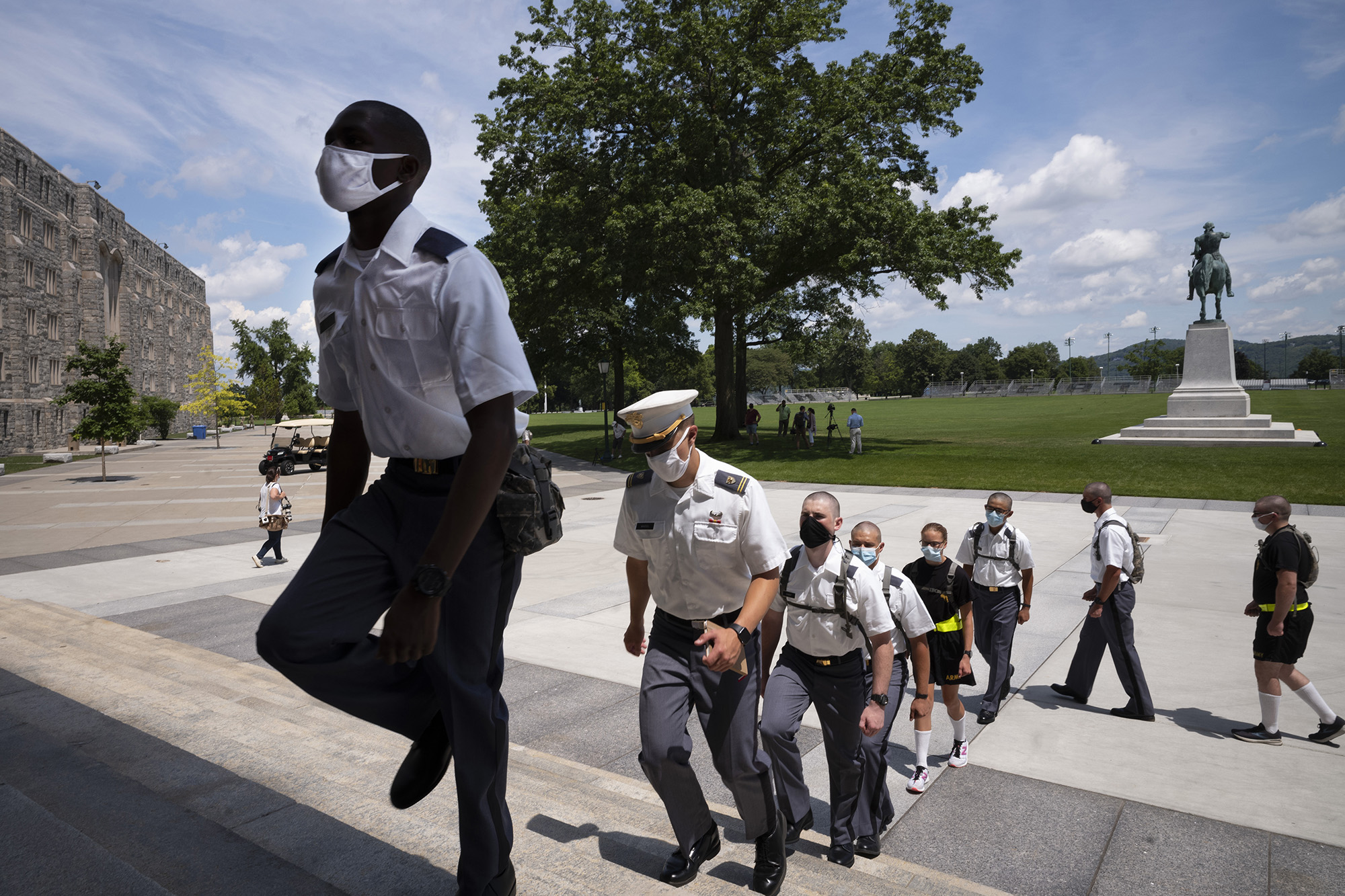 New cadets march in formation on July 13, 2020, at the U.S. Military Academy in West Point, N.Y. The Army is welcoming more than 1,200 candidates from every state. Candidates will be tested for COVID-19 immediately upon arrival, wear masks, and practice social distancing. (Mark Lennihan/AP)