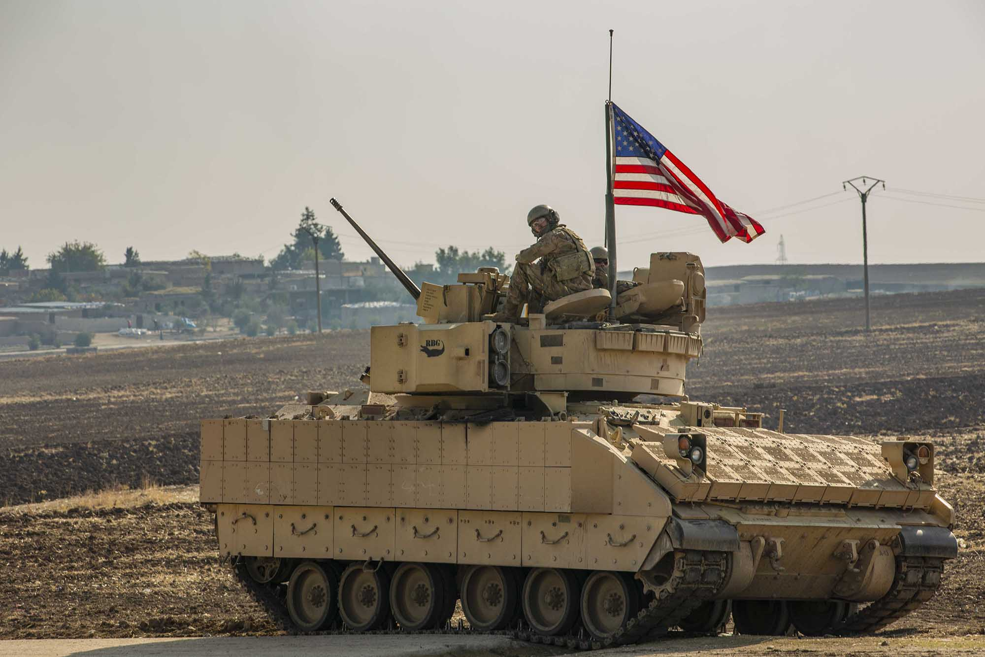 A U.S. soldier sits in the gunner's seat of a M2 Bradley Infantry Fighting Vehicle in Syria in the Central Command area of responsibility, Dec. 11, 2020. (Spc. Jensen Guillory/Army)