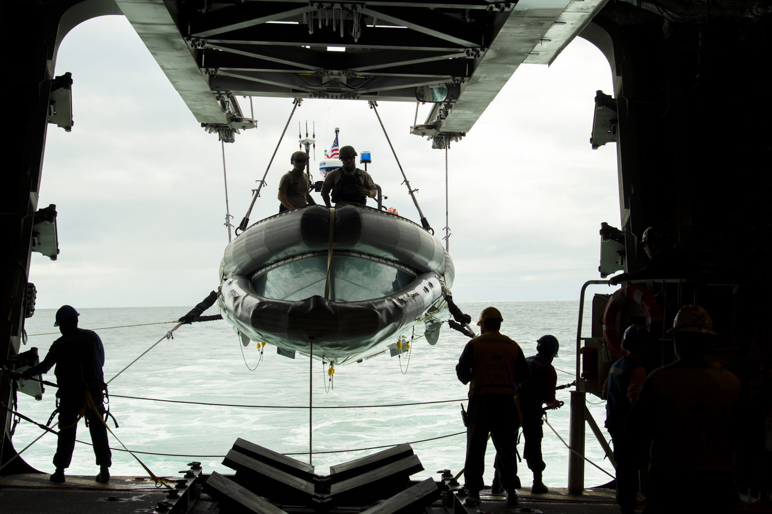 Sailors aboard the Independence-class littoral combat ship USS Gabrielle Giffords (LCS 10) lower a rigid-hulled inflatable boat in preparation for small boat operations Oct. 7, 2020, in the Pacific Ocean. (Mc2Allen Michael Amani/Navy)