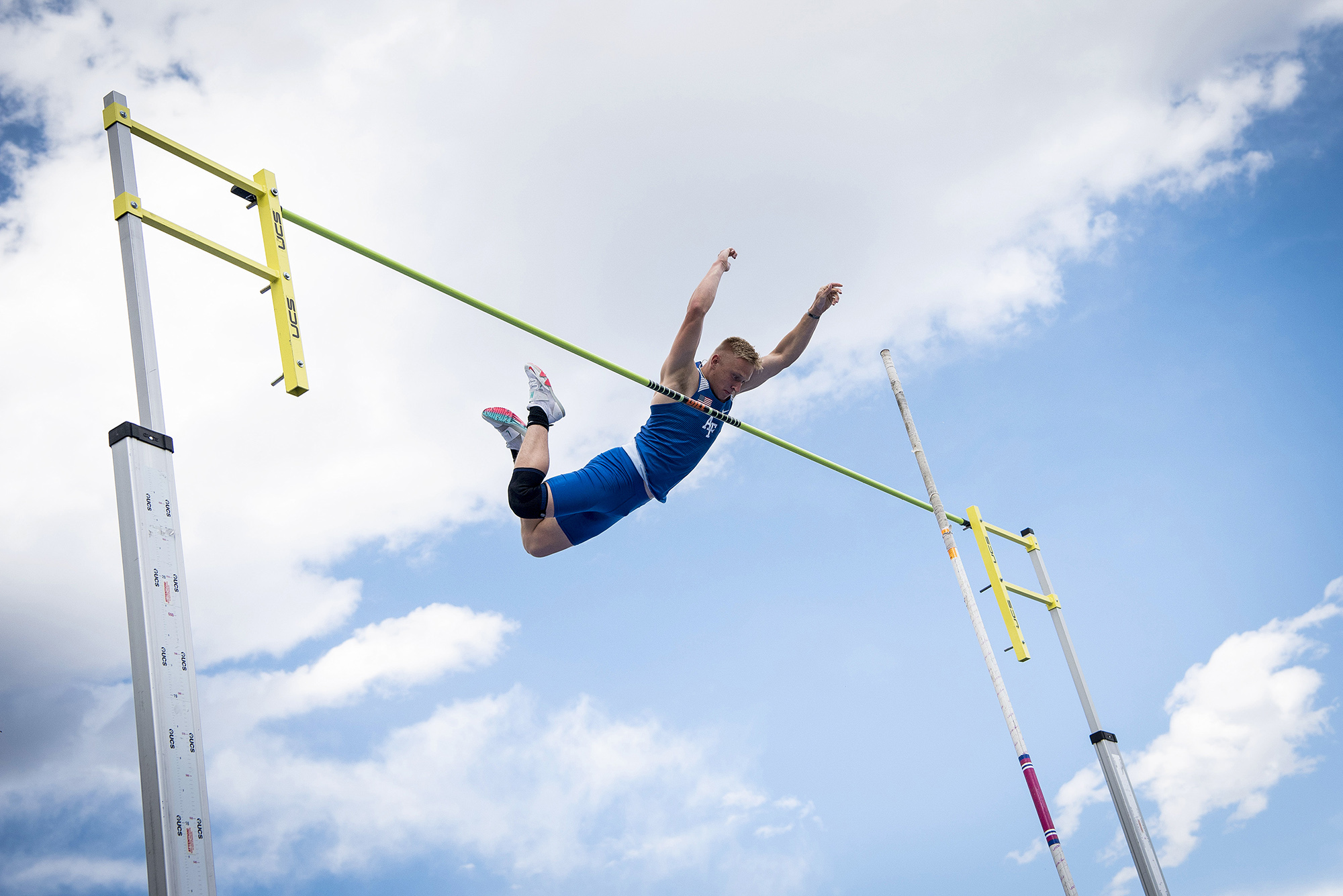 """Air Force's Tyler Gurchiek competes in the men's pole vault during the Twilight Open at the U.S. Air Force Academy's Cadet Outdoor Track and Field Complex in Colorado Spring, Colo., May 7, 2021. Gurchiek cleared a vault of 14' 1 1/4"""" during the competition. (Joshua Armstrong/Air Force)"""