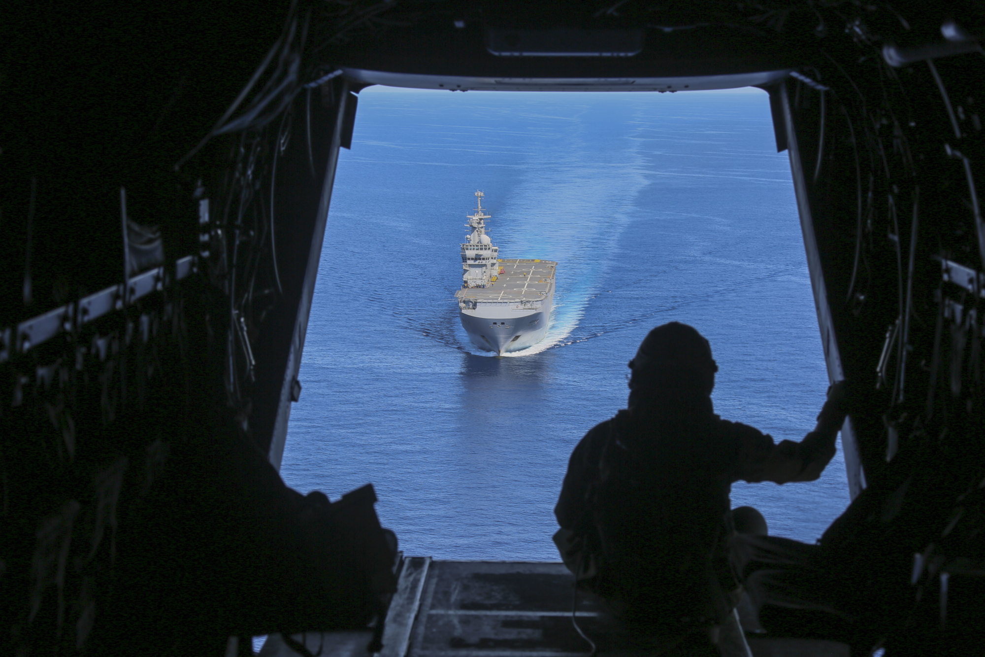 Cpl. Tyler Truong, MV-22B Osprey crew chief, observes the French Navy amphibious assault ship Mistral on June 24, 2020, in the Mediterranean Sea. (Cpl. Gary Jayne III/Marine Corps)