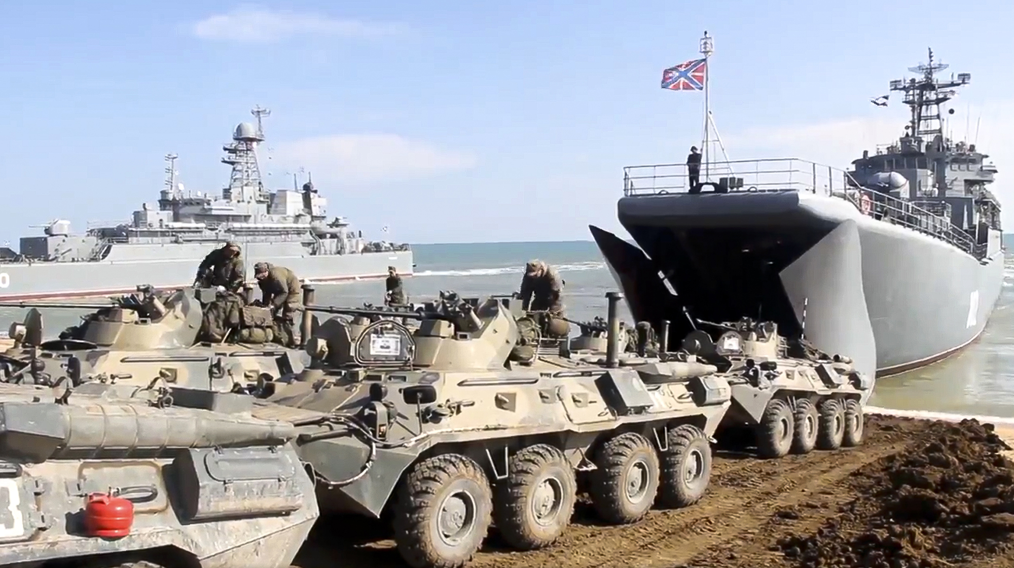 Russian military armored vehicles roll into landing vessels after drills in Crimea on April 23, 2021. (Russian Defense Ministry Press Service via AP)