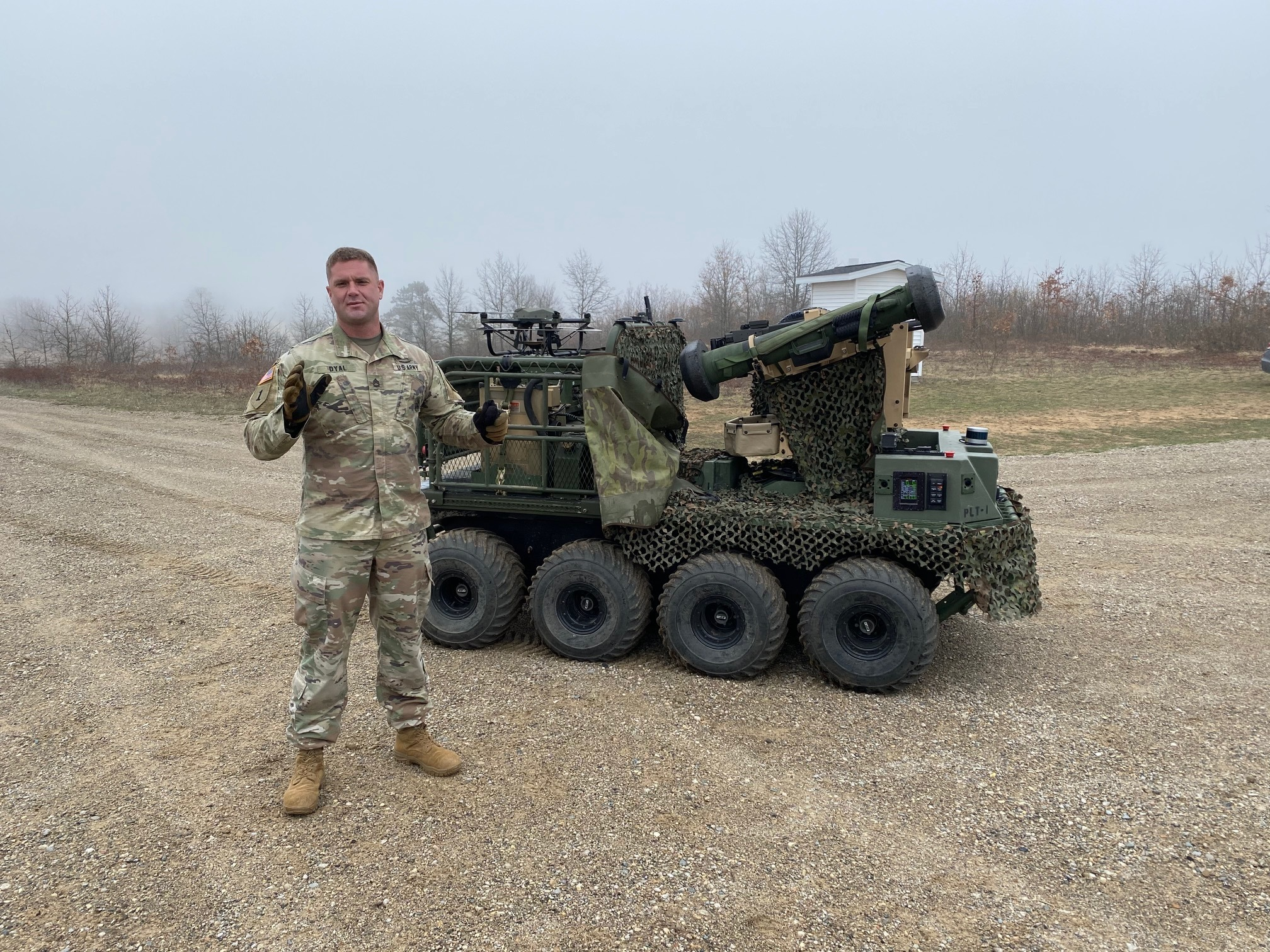 Sgt. 1st Class Richard Dyal discusses what robots can bring to light forces at Camp Grayling, Michigan, April 28, 2021. (Dan Heaton/Army)