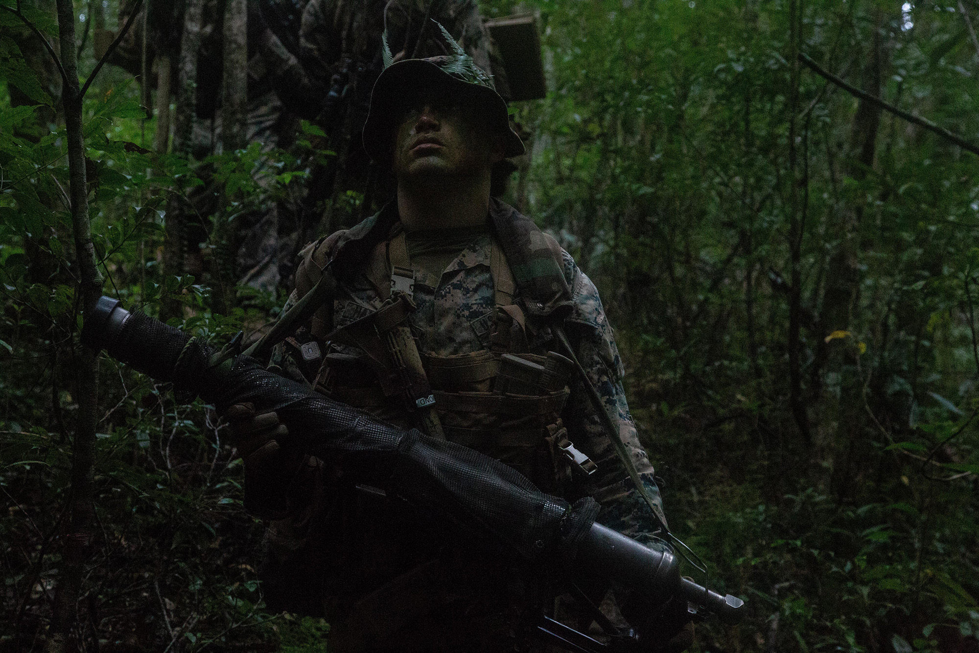 A U.S. Marine patrols during a force-on-force exercise at Camp Gonsalves, Okinawa, Japan on Oct. 16, 2020. (Lance Cpl. Kolby Leger/Marine Corps)